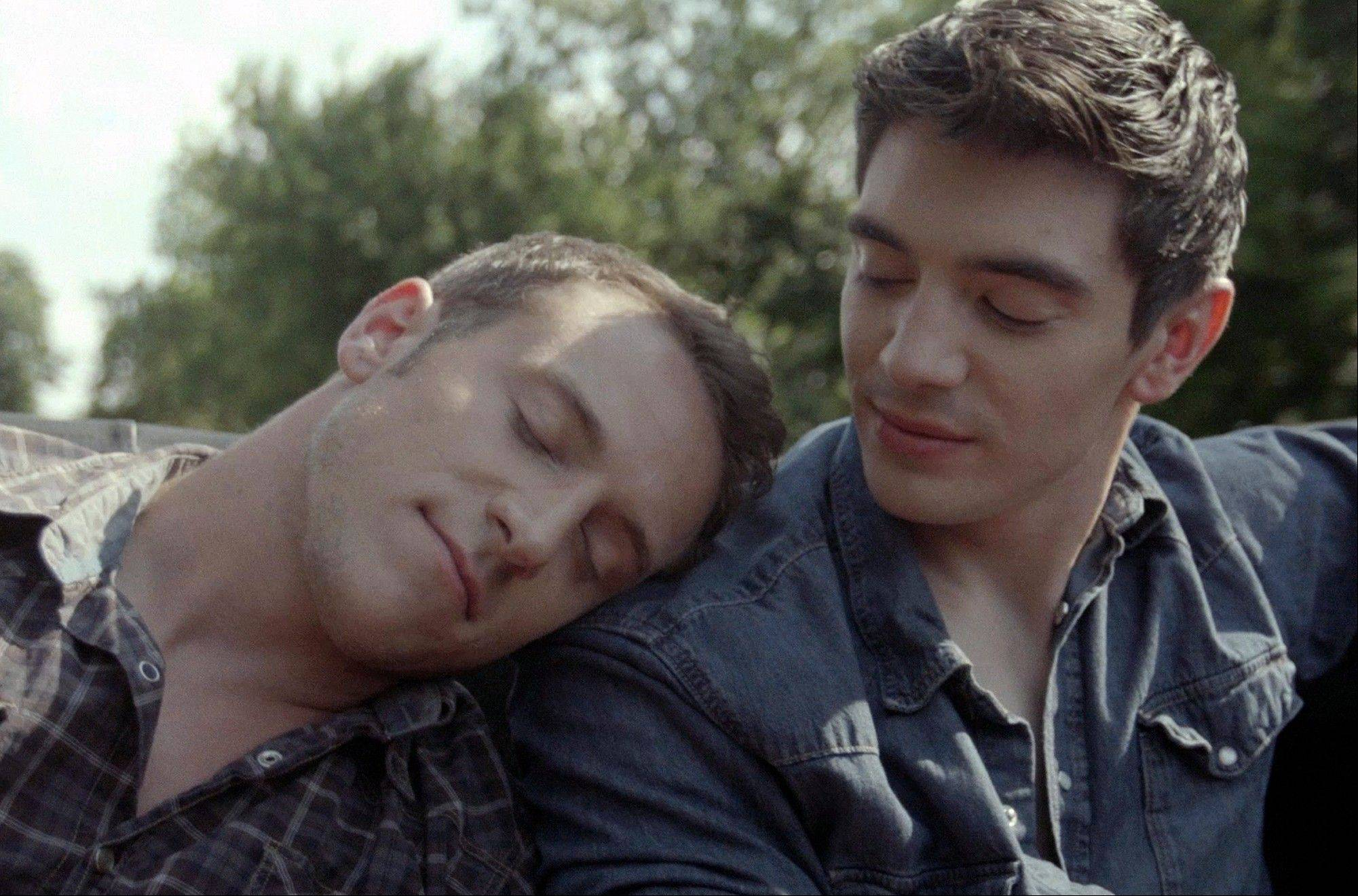 Musician Steve Grand, right, and actor Nicholas Alan appear in Grand�s music video �All-American Boy.� Grand�s self-financed, gay-themed video has been viewed more than a quarter-million times since it was posted on YouTube July 2.