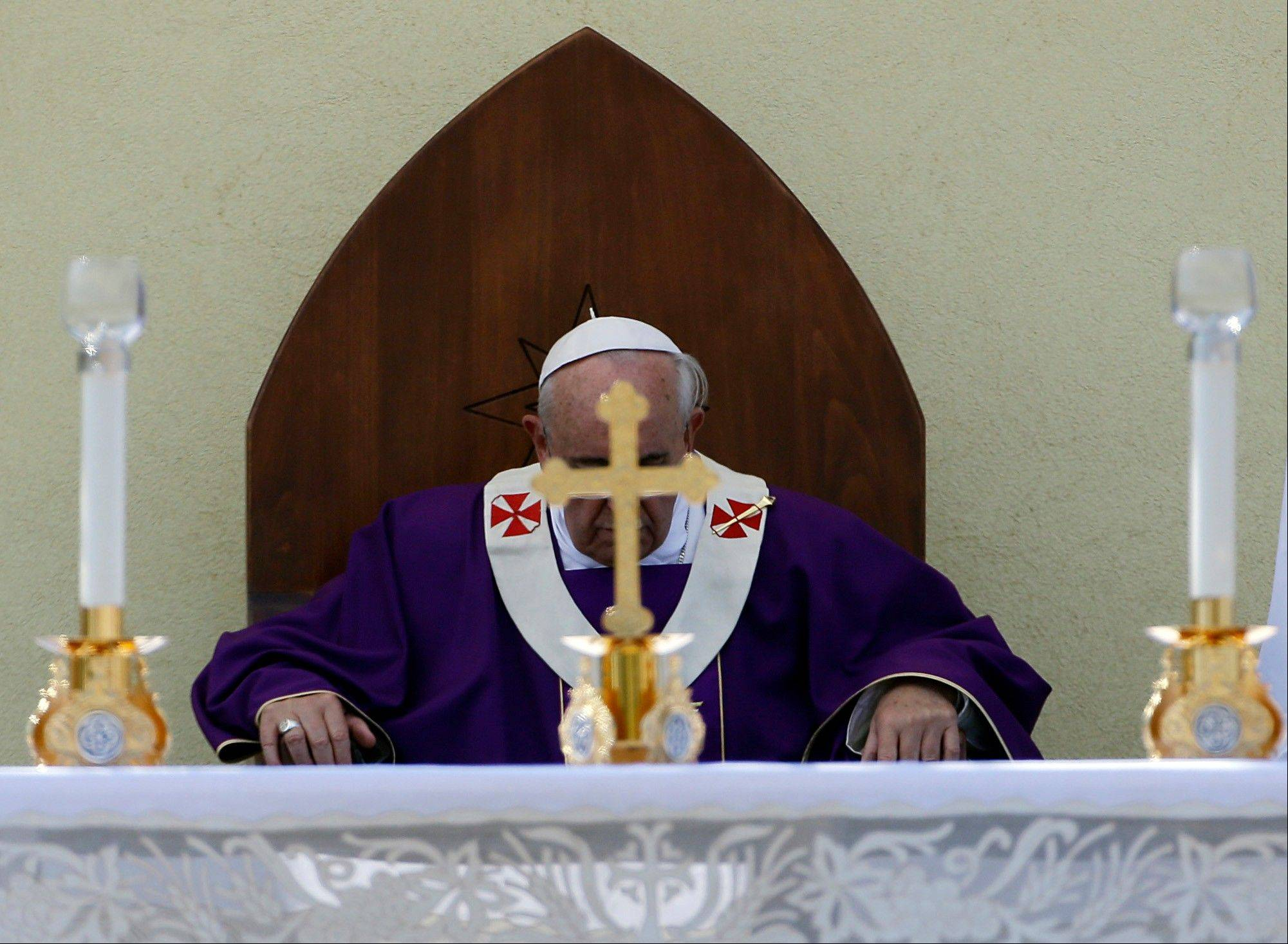 Pope Francis celebrates a mass during his visit to the island of Lampedusa, southern Italy, Monday. Pope Francis traveled Monday to the tiny Sicilian island of Lampedusa to pray for migrants lost at sea, going to the farthest reaches of Italy to throw a wreath of flowers into the sea and celebrate Mass as yet another boatload of Eritrean migrants came ashore.