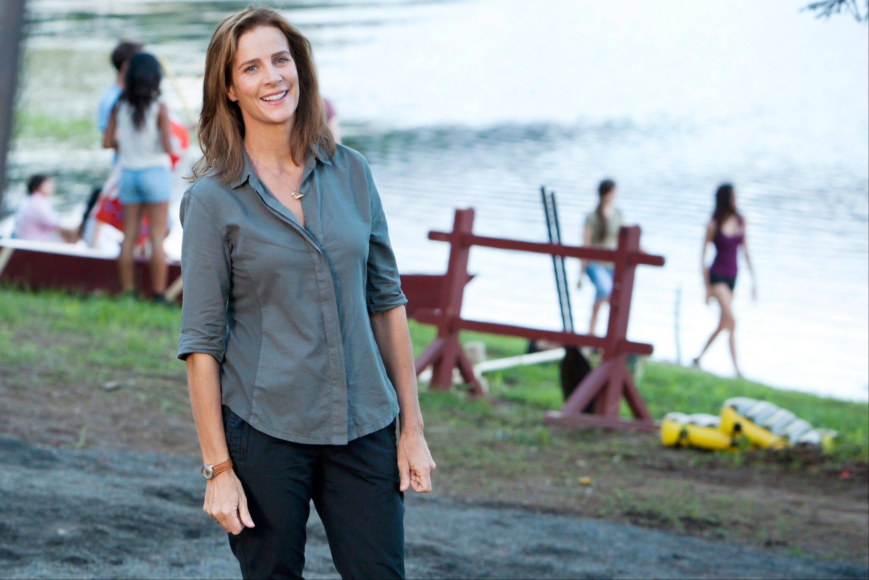 "Camp owner Mackenzie (Rachel Griffiths) must cope with a young staff, a site in need of repairs and a rival who wants to buy her land in NBC's summer series ""Camp."""