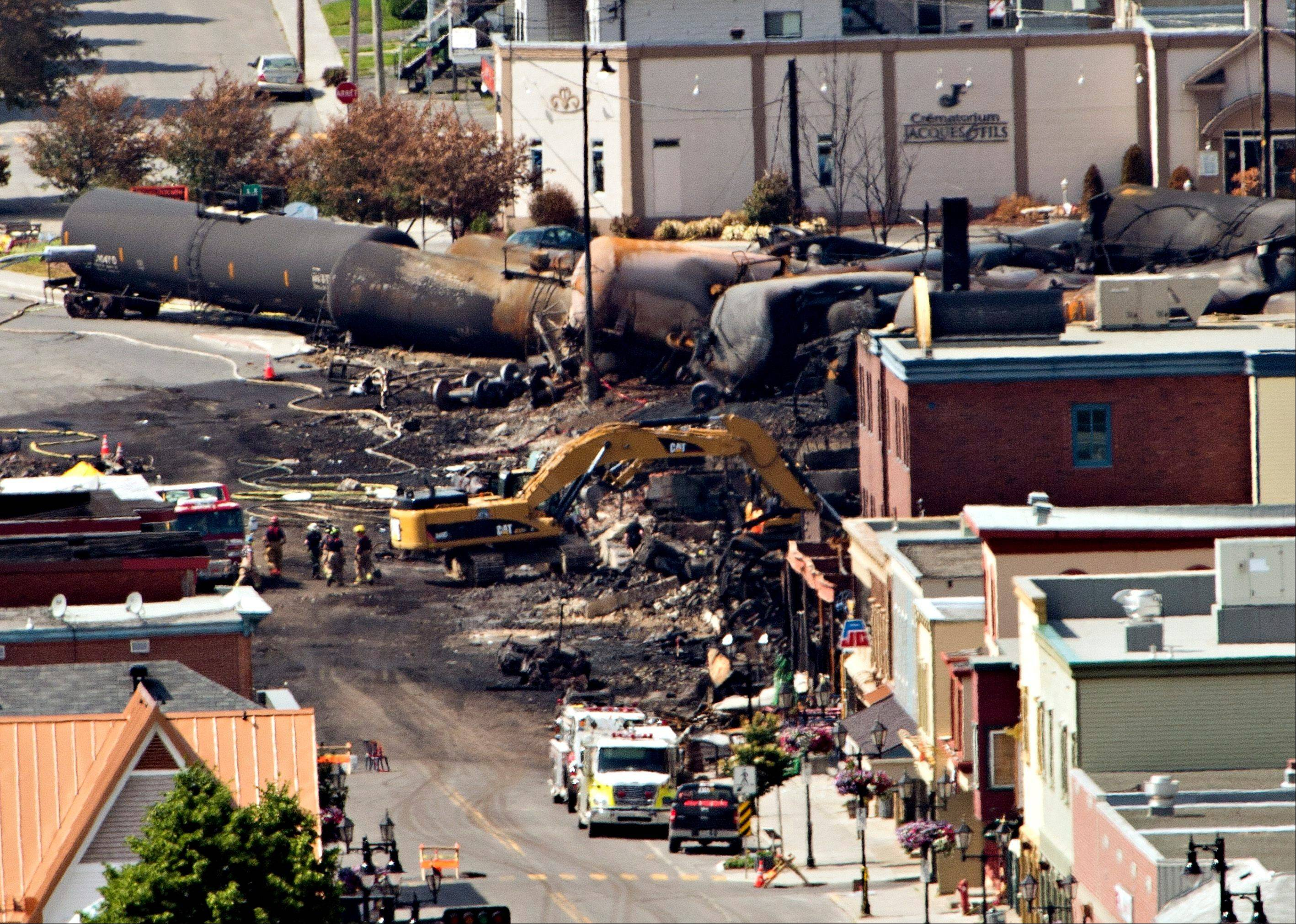 Searchers dig through the rubble for victims in Lac-Megantic, Quebec, Monday, after a train derailed, igniting tanker cars carrying crude oil early Saturday.