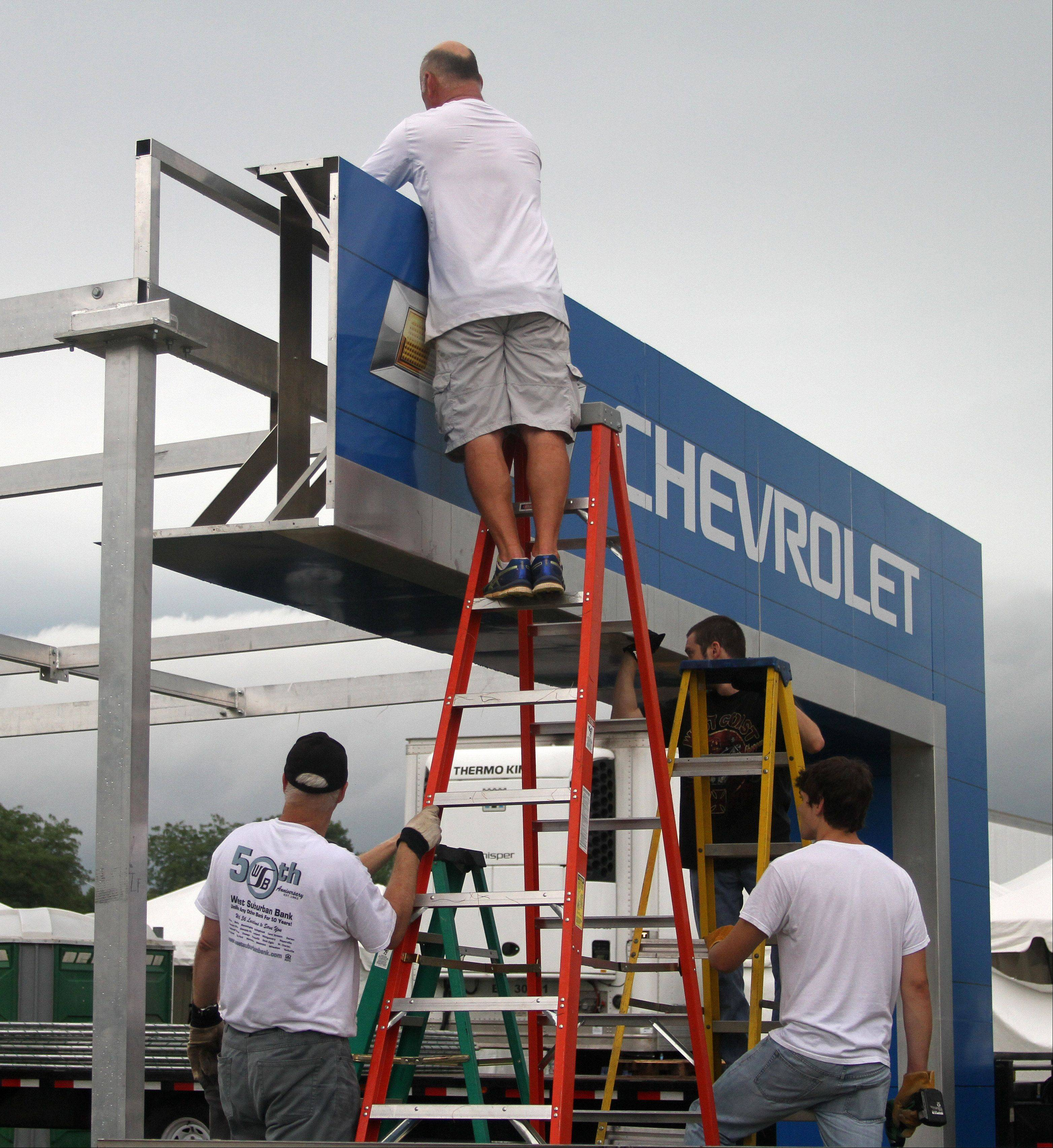Crews take apart the Chevrolet vendor booth on Naperville Ribfest grounds at Knoch Park as cleanup efforts began Monday. The 26th annual festival run by the Naperville Exchange Club concluded Sunday with a performance by Lynyrd Skynyrd.