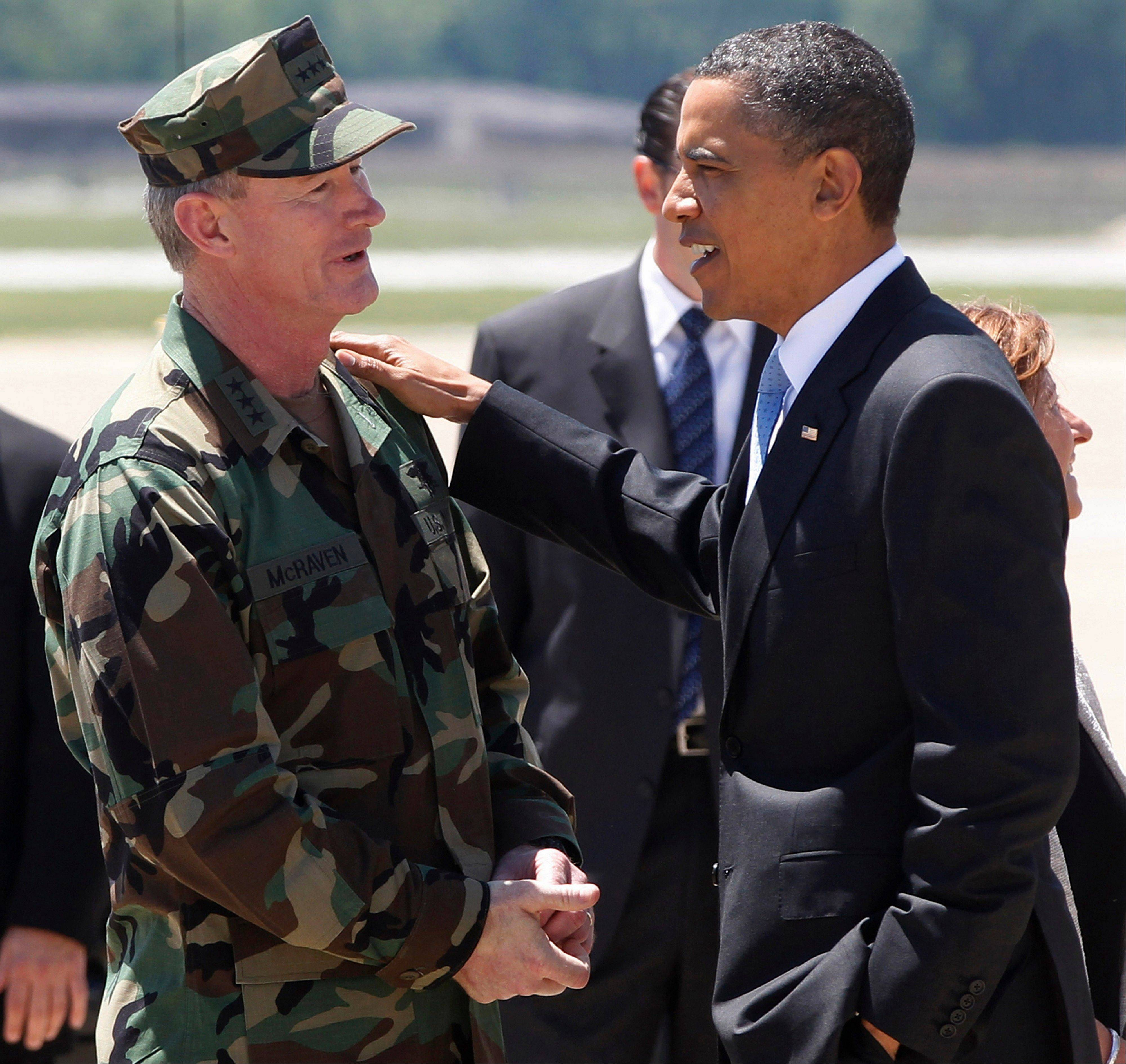 In this May 6, 2011 photo President Barack Obama talks with U.S. Navy Vice Admiral William H. McRaven, commander of Joint Special Operations Command (JSOC), at Campbell Army Airfield in Fort Campbell, Ky., just days after McRaven led operational control of Navy SEAL Team Six's successful mission to get Osama bin Laden.