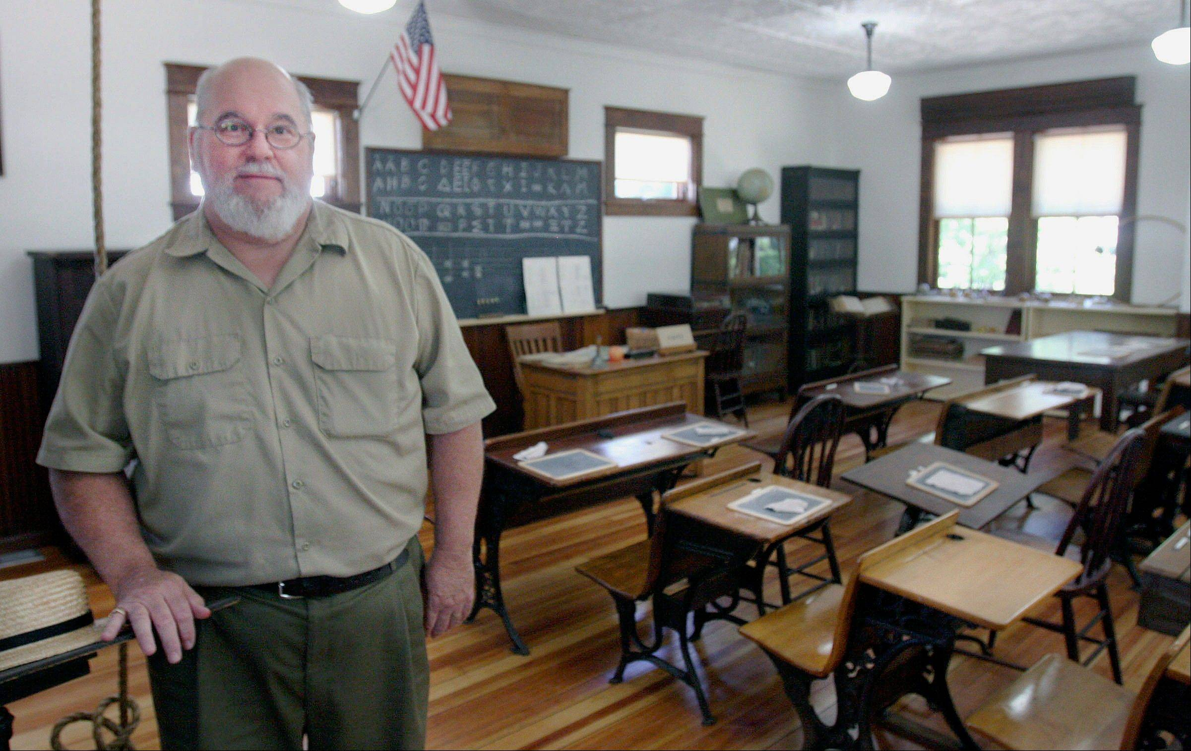 Associated PressEd Finch, executive director of the Stephenson County Historical Society, in the recently restored Millerburg Schoolhouse at the museum in Freeport.