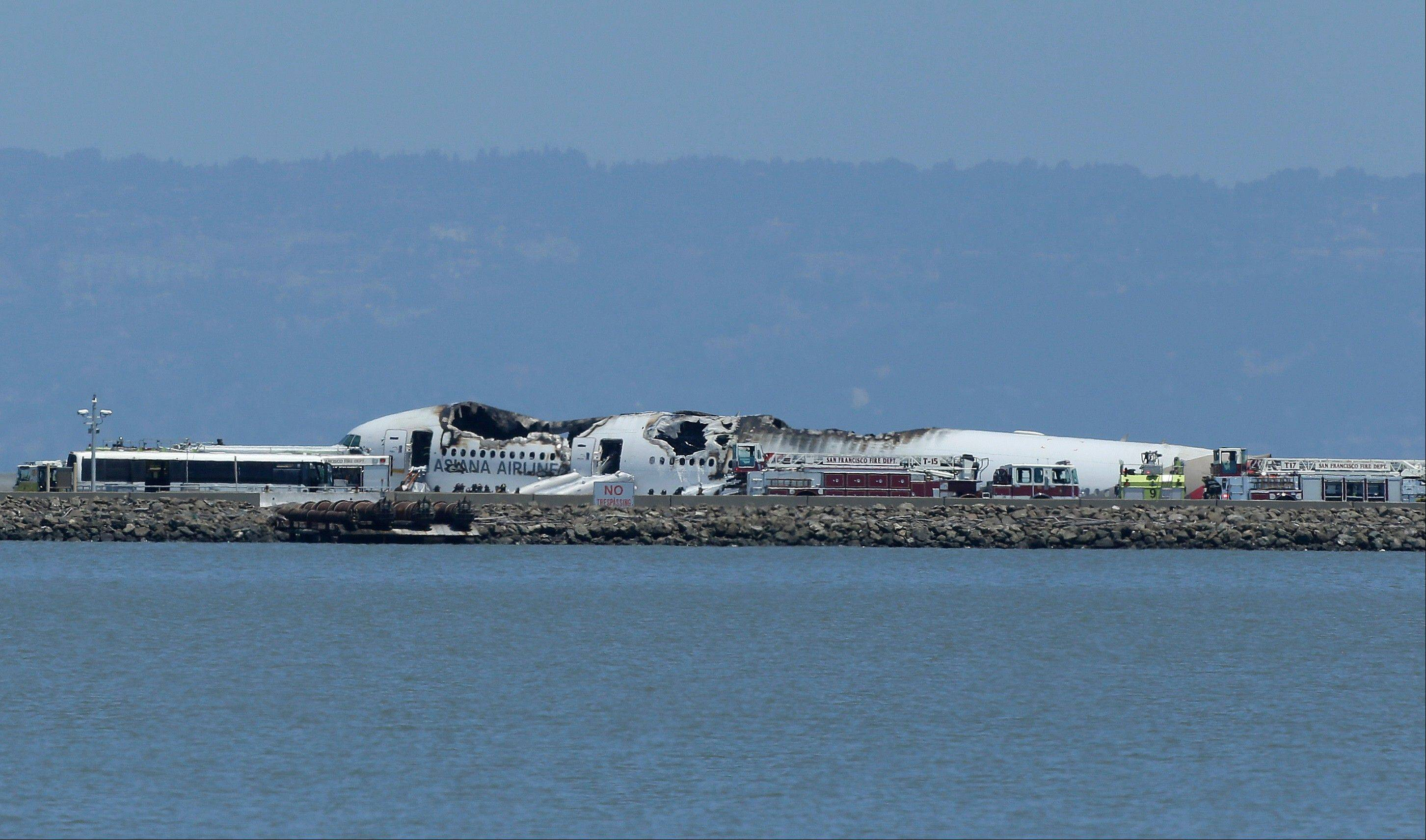 The evacuation of Asiana Flight 214, which crashed at San Francisco International Airport Saturday, began badly. Even before the mangled jetliner began filling with smoke, two evacuation slides on the doors inflated inside the cabin instead of outside, pinning two flight attendants to the floor.