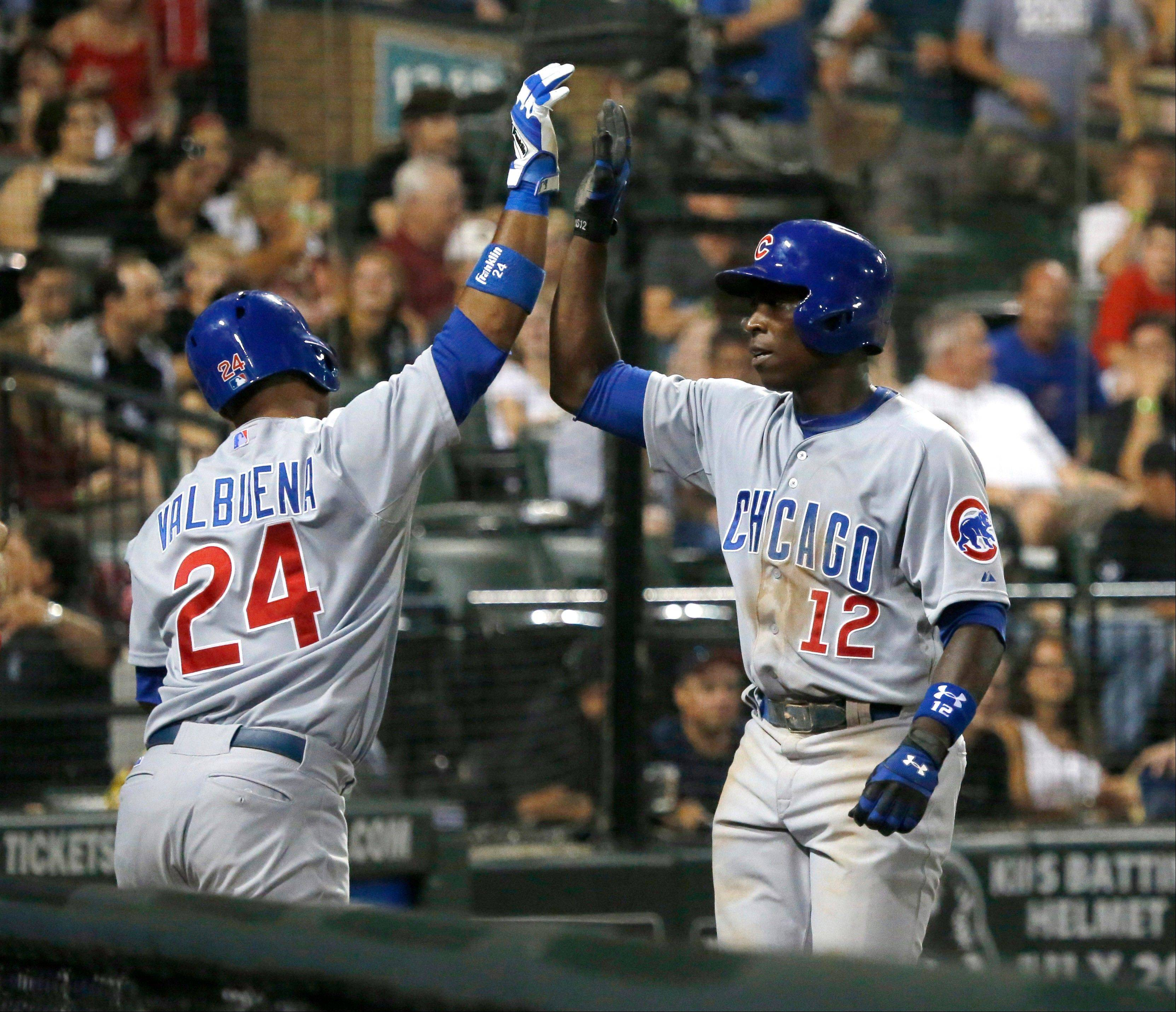 Luis Valbuena greets his Cubs teammate Alfonso Soriano after Soriano's homer off White Sox starter Hector Santiago in Monday's sixth inning at U.S. Cellular Field.