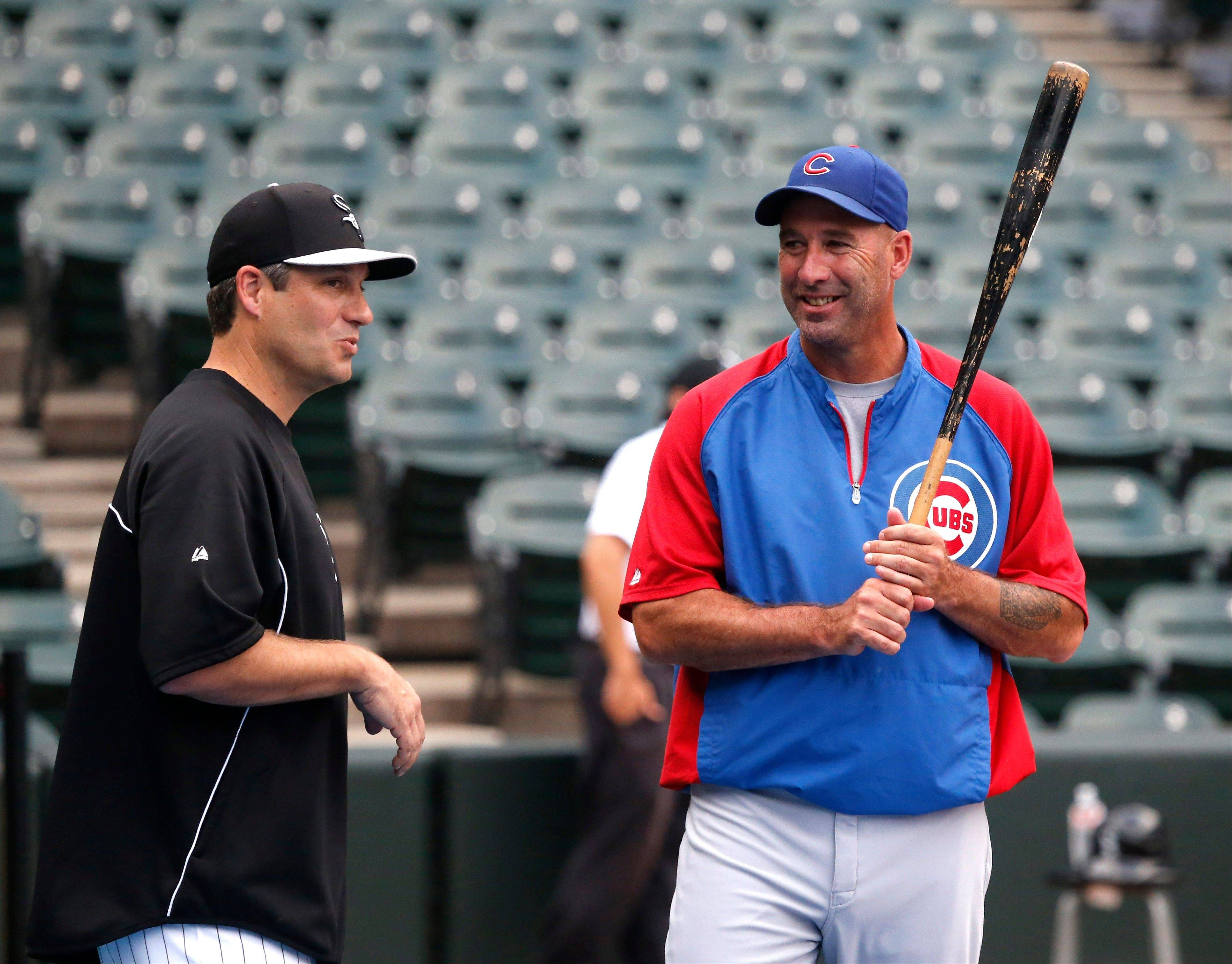 White Sox manager Robin Ventura, left, and Cubs manager Dale Sveum talk before Monday's game at U.S. Cellular Field.