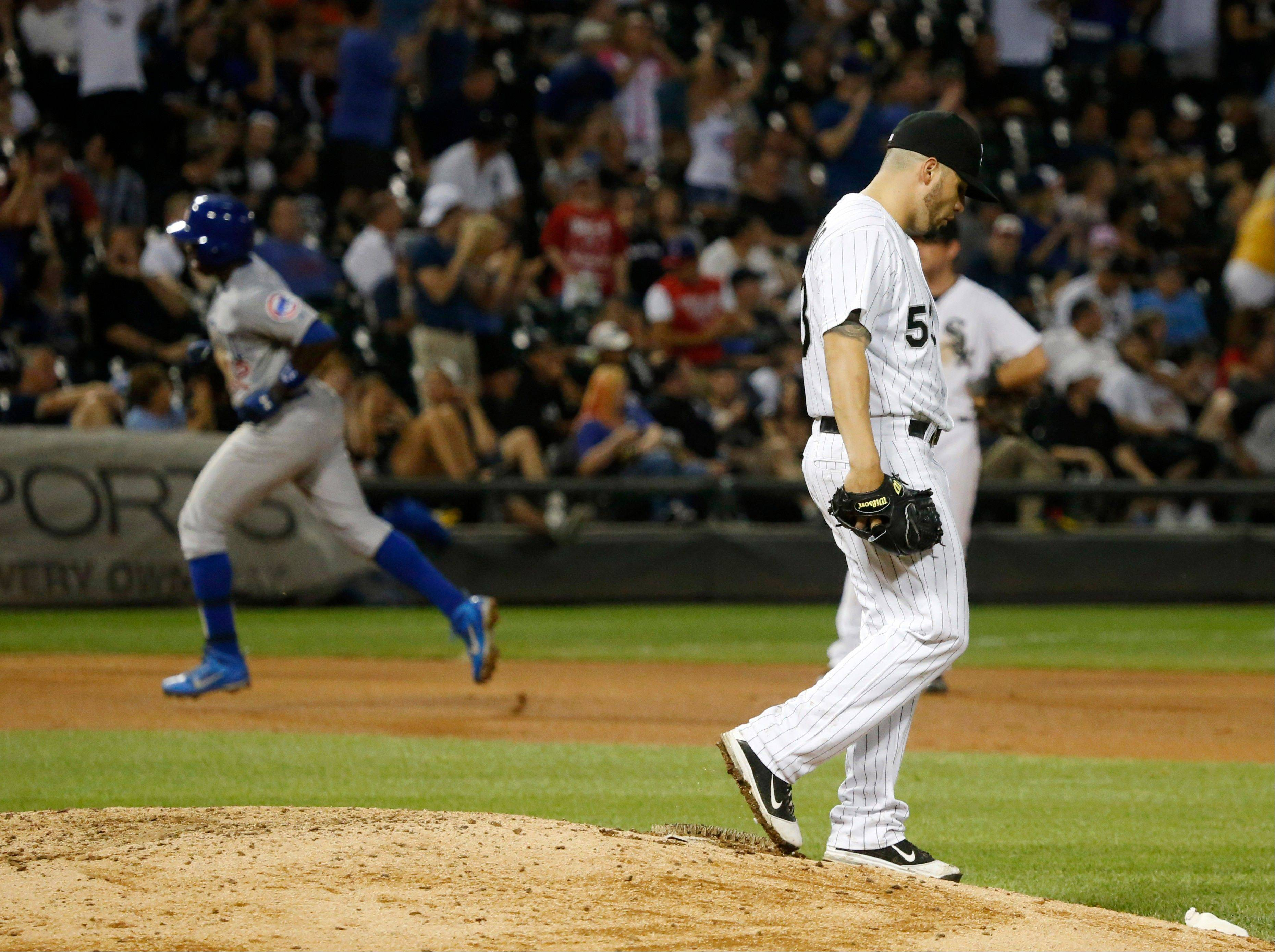 White Sox starting pitcher Hector Santiago, right, walks off the mound after giving up a homer to Alfonso Soriano of the Cubs Monday at U.S. Cellular Field.