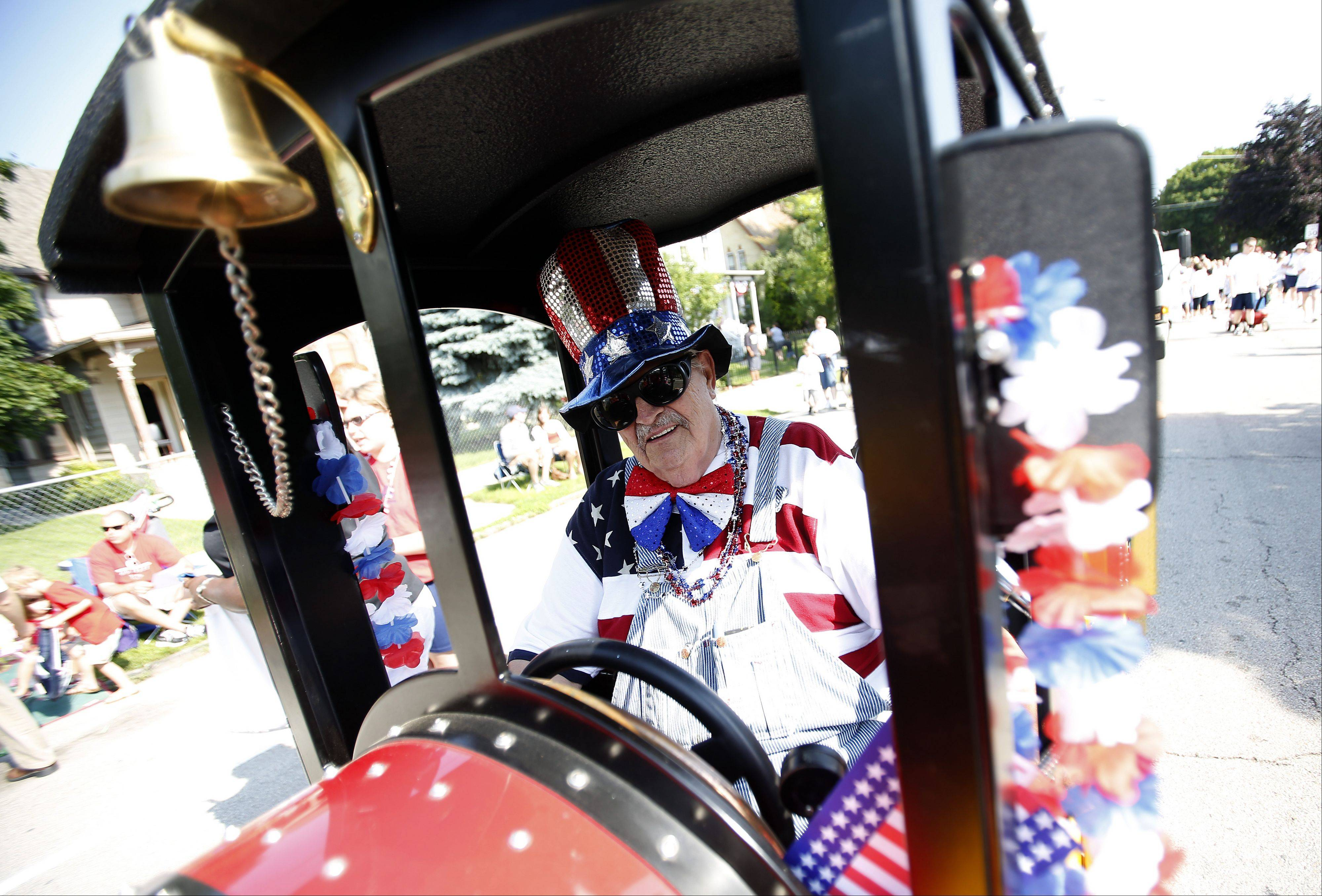 Bob Christensen of Sycamore pilots a small train during the 2013 Elgin Fourth of July Parade.