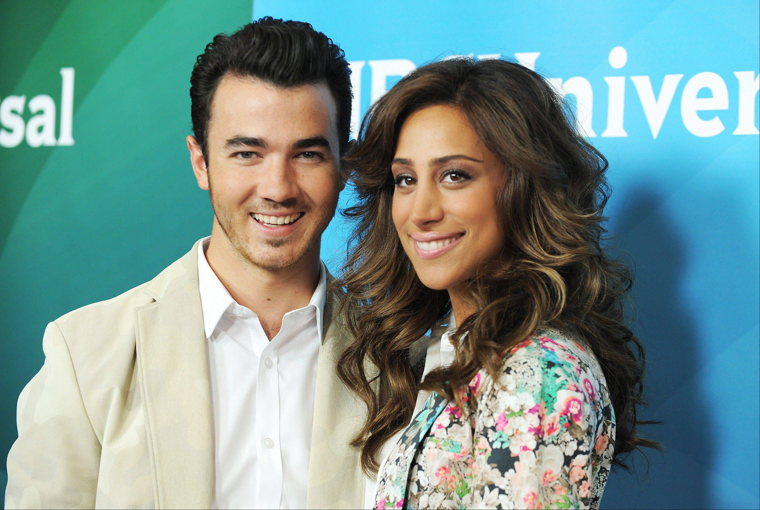In this July 25, 2012, file photo, Kevin Jonas and Danielle Jonas attend the second day of NBCUniversal's 2012 Summer Press Tour at the Beverly Hilton Hotel in Beverly Hills, Calif. A representative for the Jonas Brothers says Kevin and wife, Danielle, are expecting their first child. The two married in 2009.
