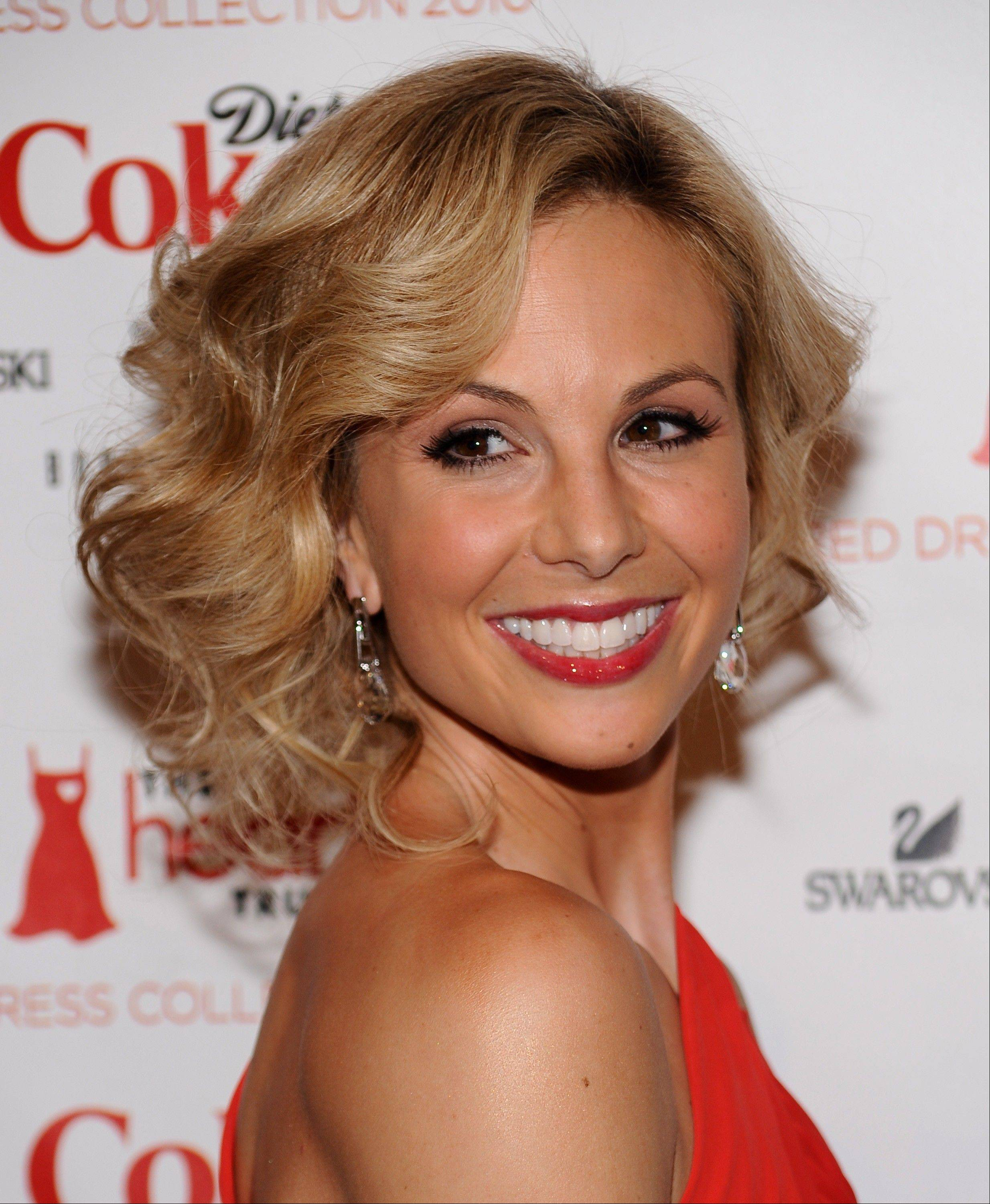 In this Feb. 11, 2010 file photo, television personality Elisabeth Hasselbeck arrives at The Heart Truth�s Red Dress Collection 2010 fashion show in New York. Hasselbeck is leaving the desk at �The View� for the couch on Fox News Channel�s �Fox & Friends.� The news network said Tuesday, July 9, 2013, that Hasselbeck, who has been on Barbara Walters� syndicated daytime show for a decade, will join co-anchors Steve Doocy and Brian Kilmeade on Fox�s morning show in September.