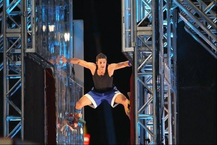"Andrew Lowes, of Grayslake, swings through the finals course in Season 4 of ""American Ninja Warrior."" Lowes, 30, is now a contestant in Season 5."