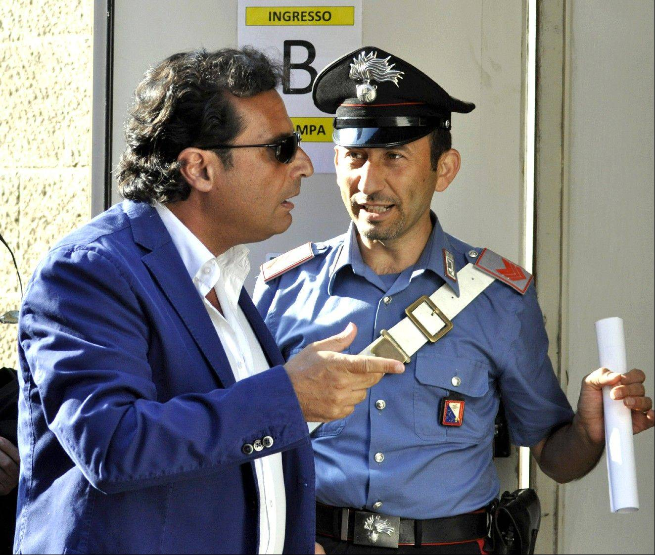 Captian Francesco Schettino arrives for his trial in Grosseto, Italy, Tuesday. The trial of the captain of the shipwrecked Costa Concordia cruise liner has begun in a theater converted into a courtroom in Tuscany to accommodate all the survivors and relatives of the 32 victims who want to see justice carried out in the 2012 tragedy.