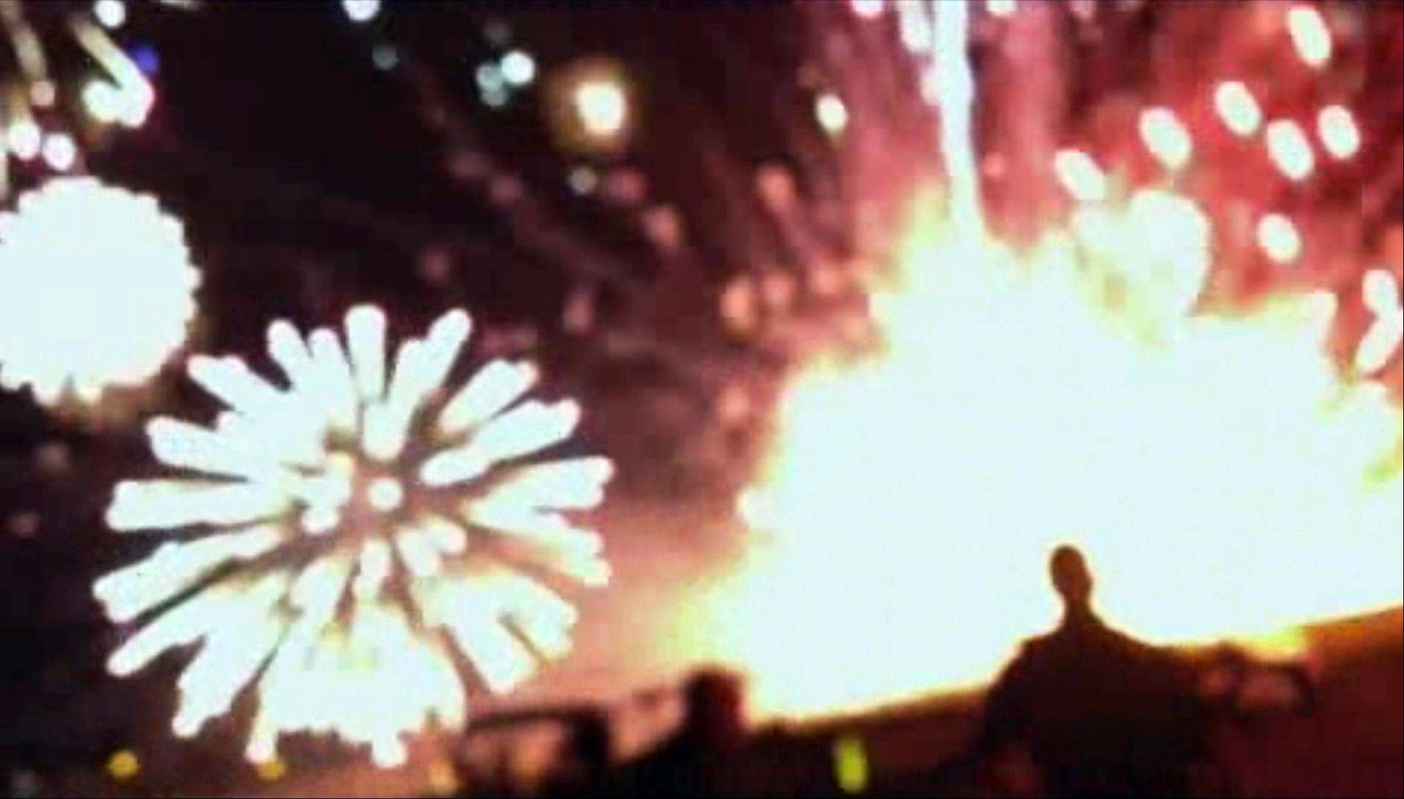 In this frame grab from video provided by Zach Reister, authenticated by checking against known locations and events, and consistent with Associated Press reporting, fireworks explode in the air and on the ground during a fireworks show in Simi Valley, Calif., Thursday, July 4, 2013. More than two dozen people were injured.