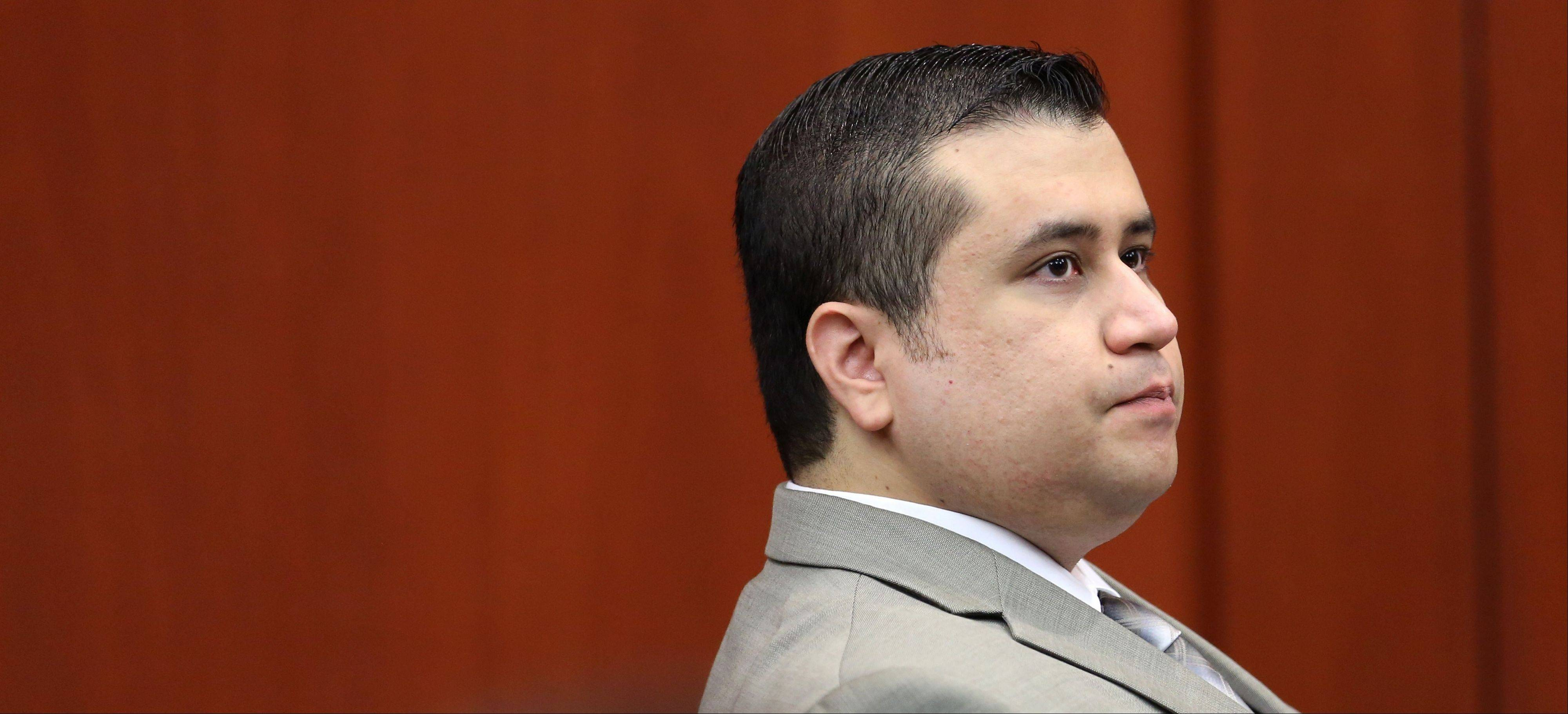 George Zimmerman listens at his trial in Seminole Circuit Court, in Sanford, Fla., Tuesday, July 9, 2013. Zimmerman is charged with second-degree murder in the fatal shooting of Trayvon Martin, an unarmed teen, in 2012.