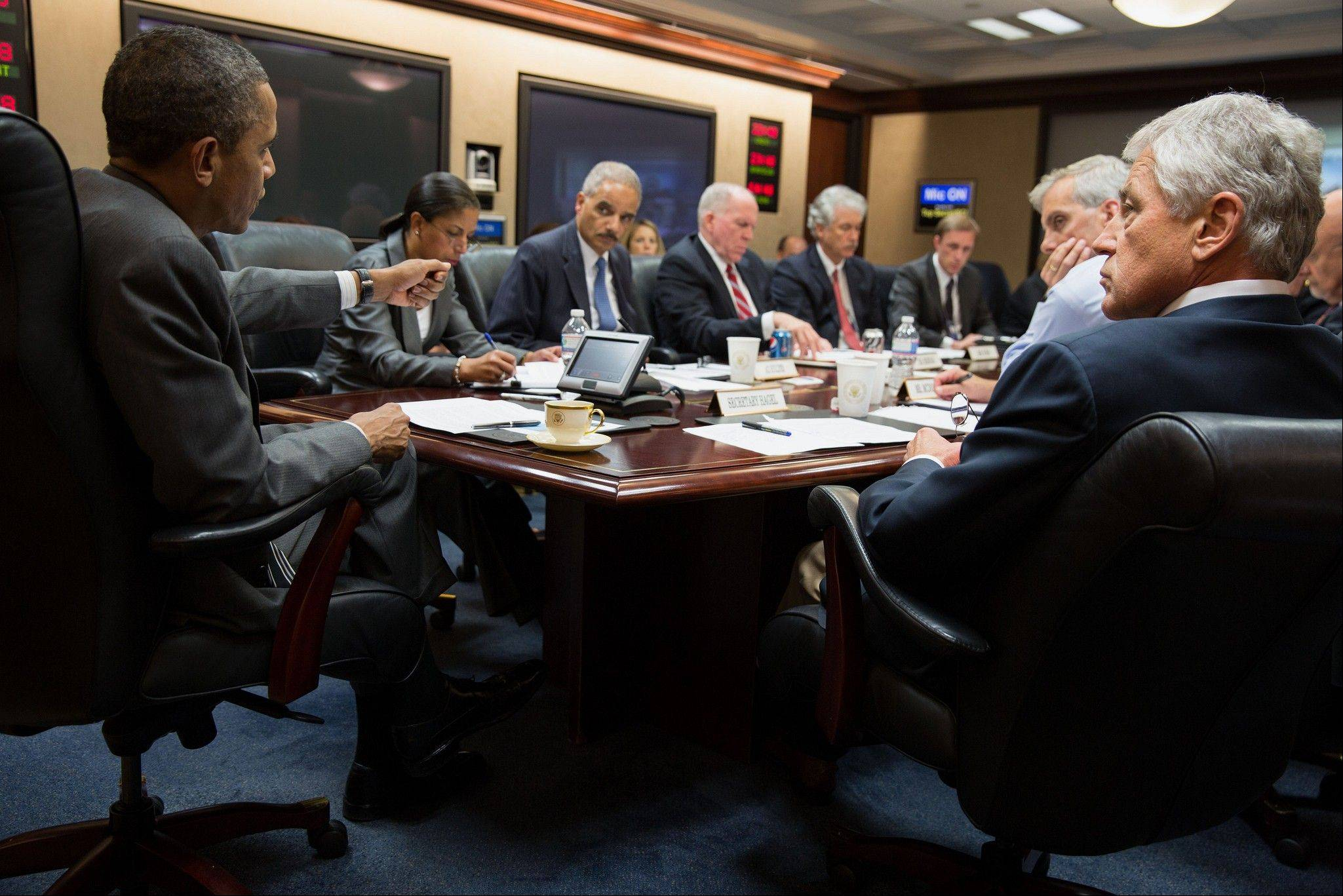 President Barack Obama, left, meets with members of his national security team to discuss the situation in Egypt in the Situation Room of the White House in Washington. While the Obama administration throws its support behind Egypt�s military, some members of Congress are looking at withholding some or all of America�s annual $1.5 billion aid package if a civilian government isn�t quickly restored.