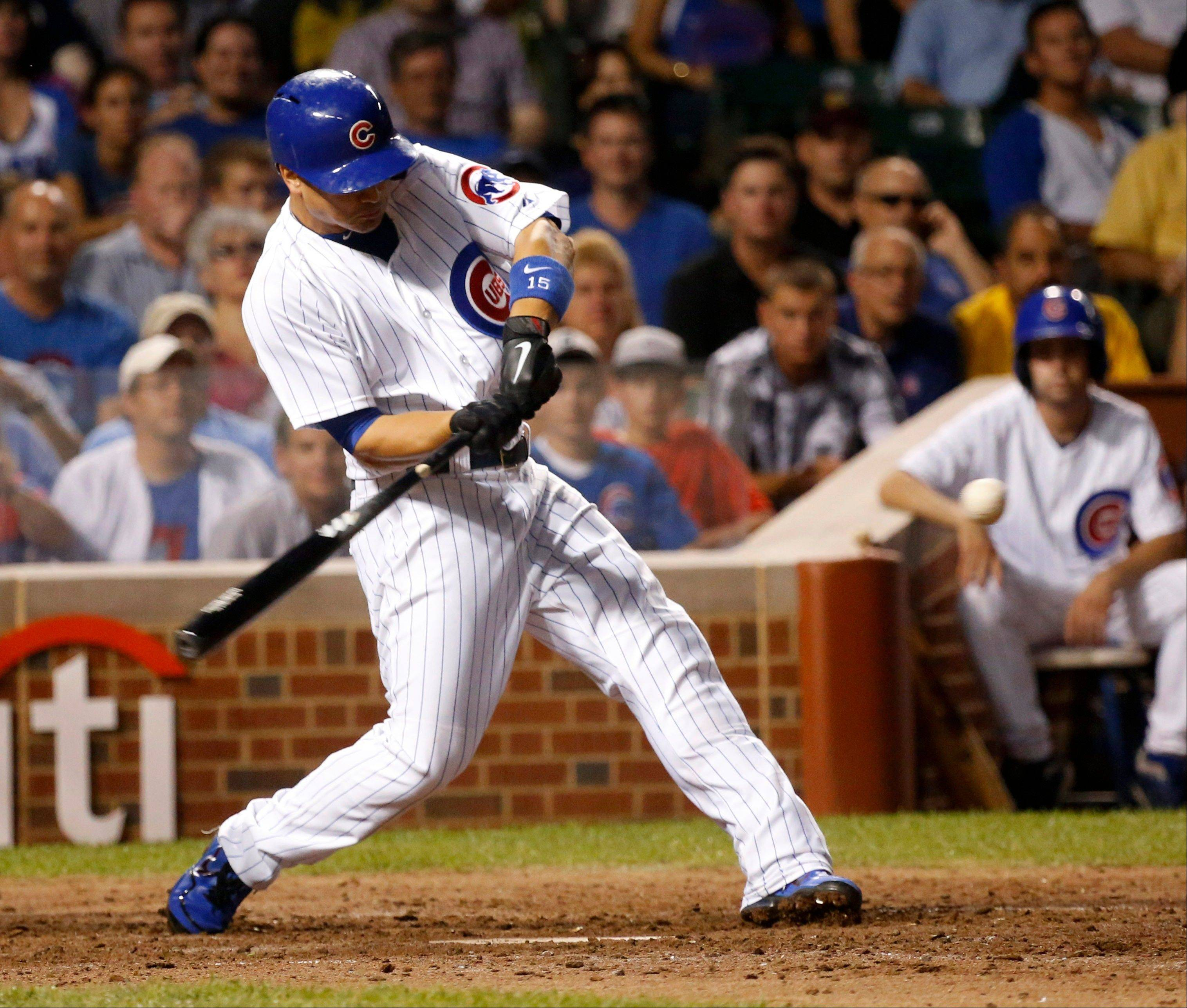 The Cubs� Darwin Barney swings on a three-run home run off Los Angeles Angels starting pitcher Joe Blanton during Tuesday night�s game at Wrigley Field.