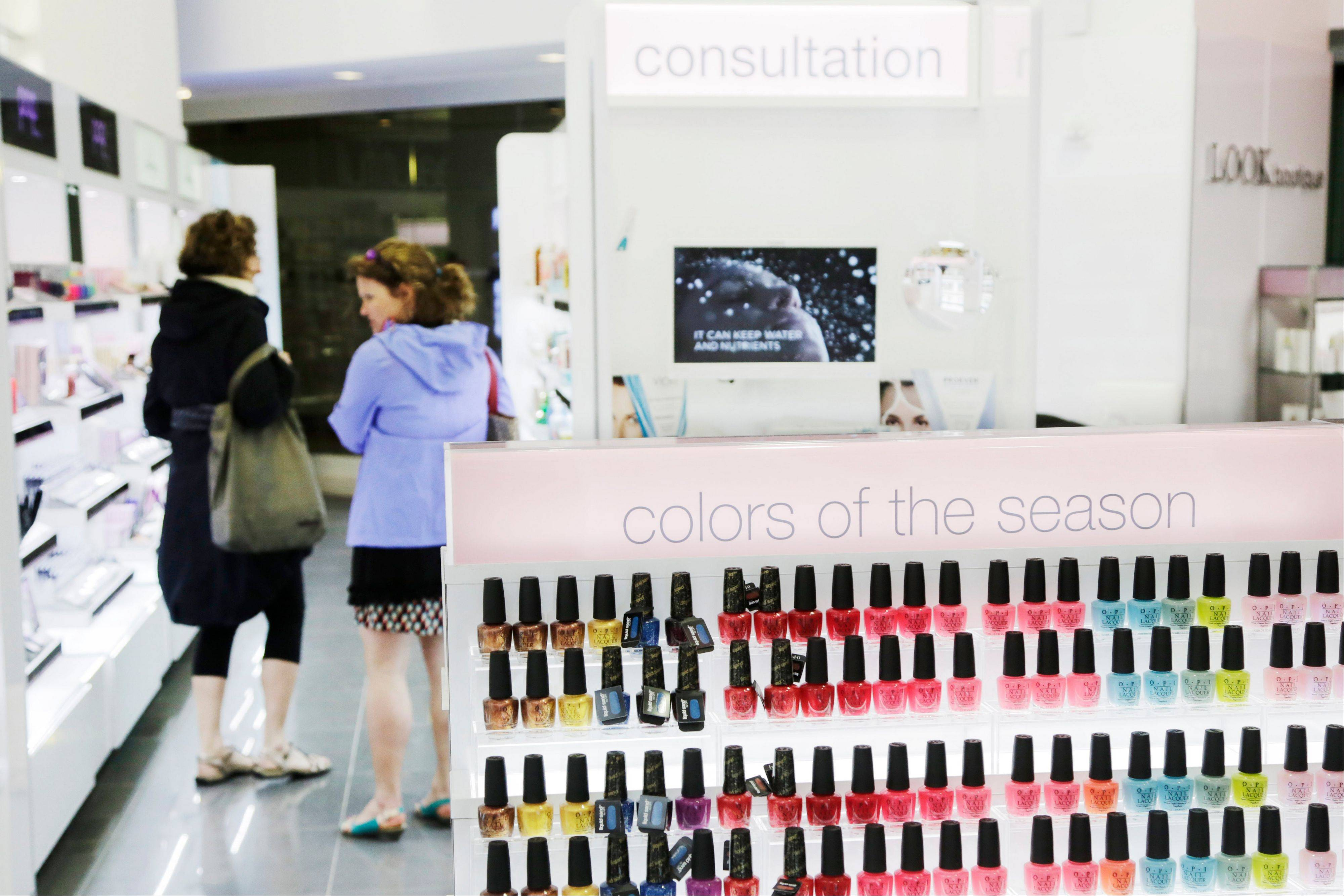 Customers browse through the Look Boutique at the Walgreens store in the Empire State Building, in New York. Americans stepped up their borrowing by $19.6 billion in May compared with April.