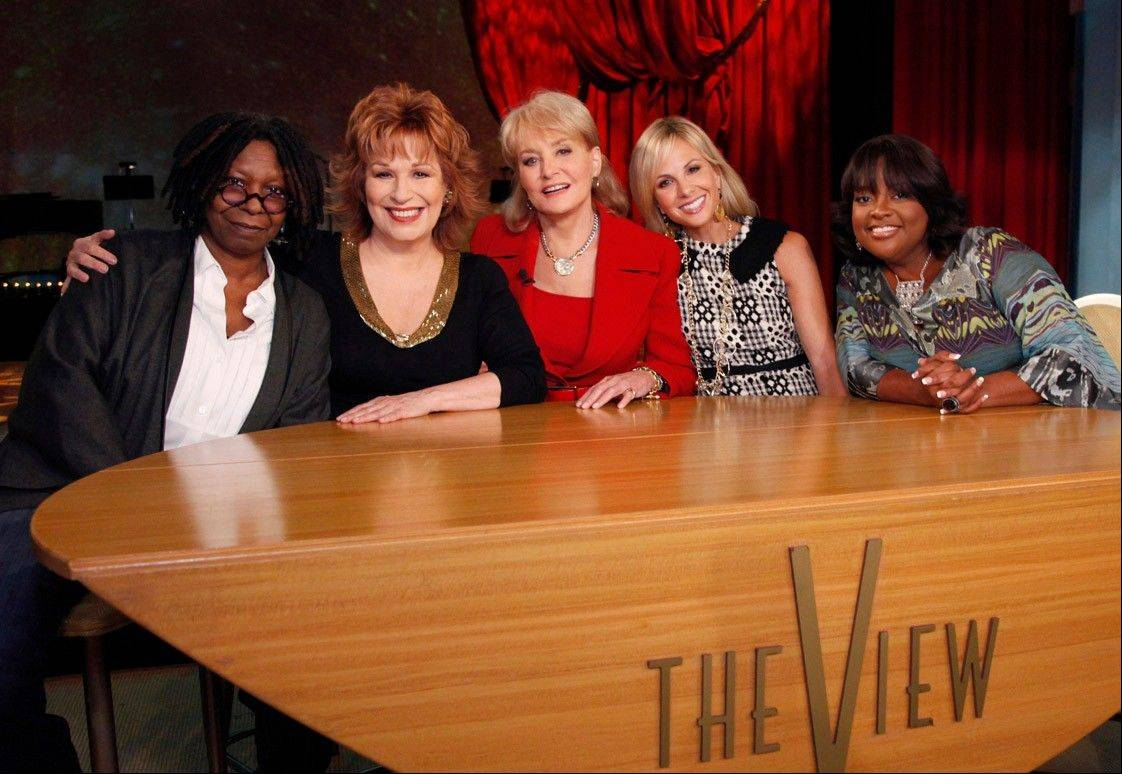 "In this file TV publicity image released by ABC, from left, Whoopi Goldberg, Joy Behar, Barbara Walters, Elizabeth Hasselbeck and Sherri Shepherd pose on the set of their daytime talk show, ""The View."" Hasselbeck is leaving the desk at ""The View"" for the couch on Fox News Channel's ""Fox & Friends."" The news network said Tuesday, July 9, 2013, that Hasselbeck, who has been on Barbara Walters� syndicated daytime show for a decade, will join co-anchors Steve Doocy and Brian Kilmeade on Fox�s morning show in September."
