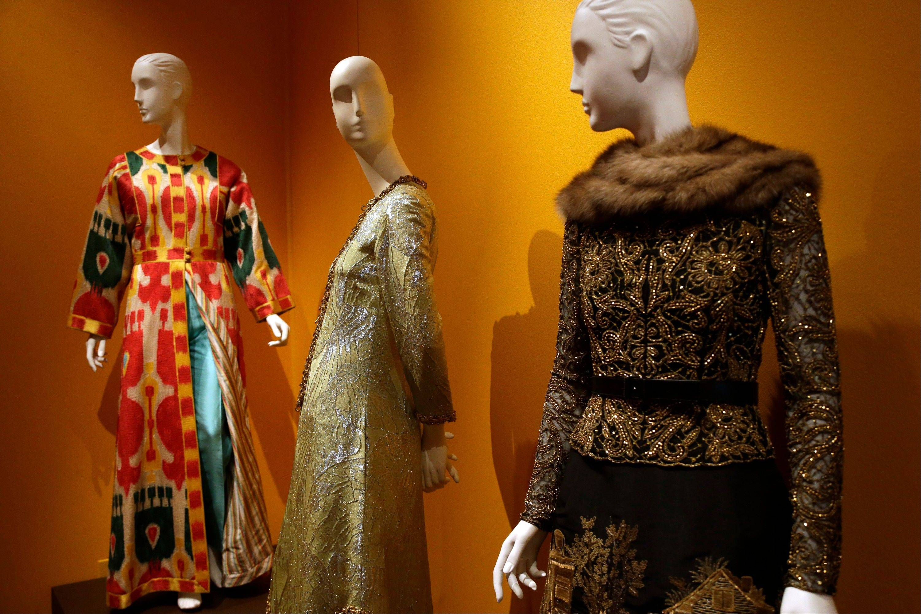 Evening ensemble creations by fashion designer Oscar de la Renta are displayed at the Clinton Presidential Library in Little Rock, Ark.