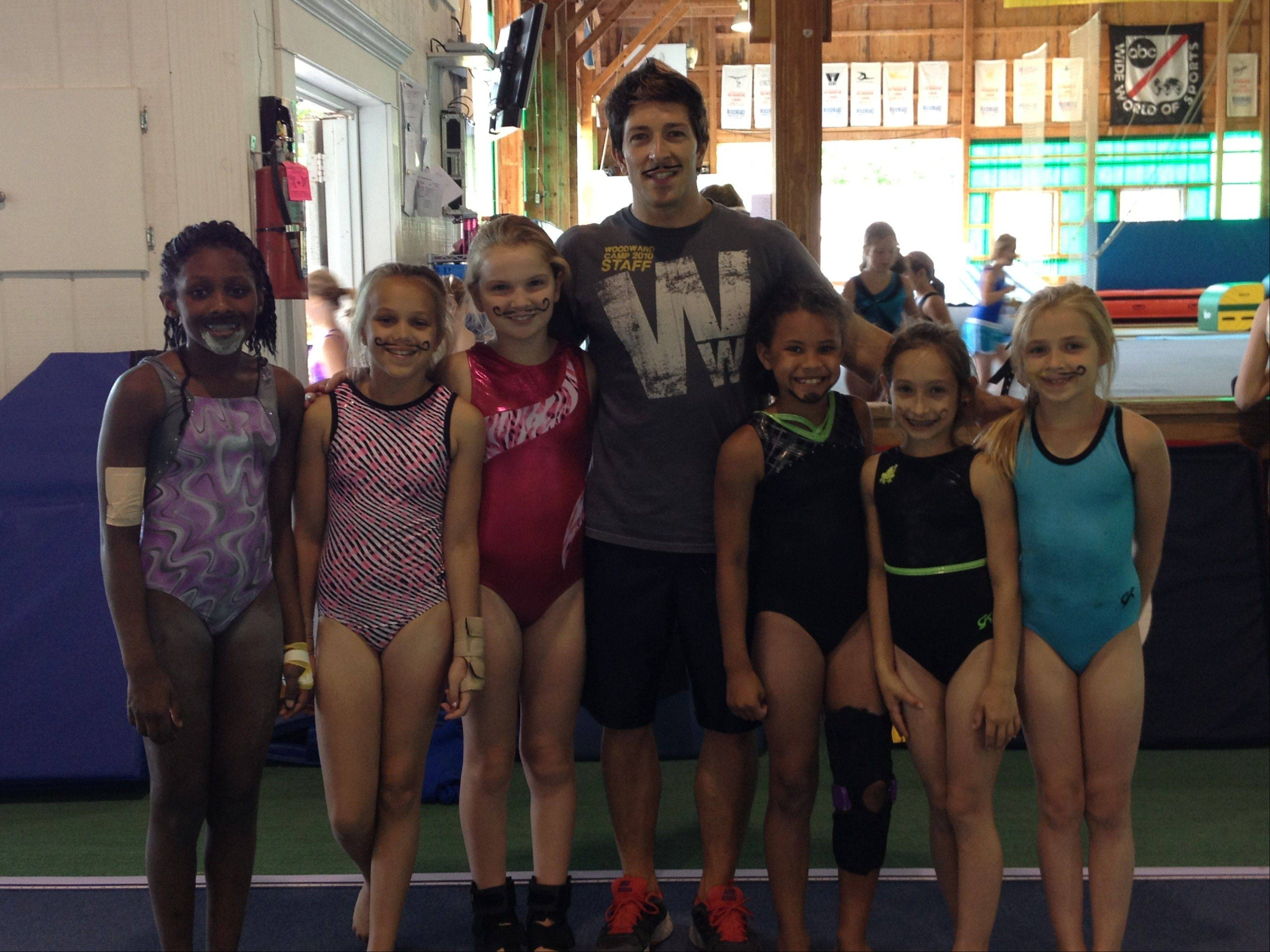 """American Ninja Warrior"" competitor Andrew Lowes of Grayslake poses on ""Mustache Day"" with some of the gymnasts he coaches in Pennsylvania."