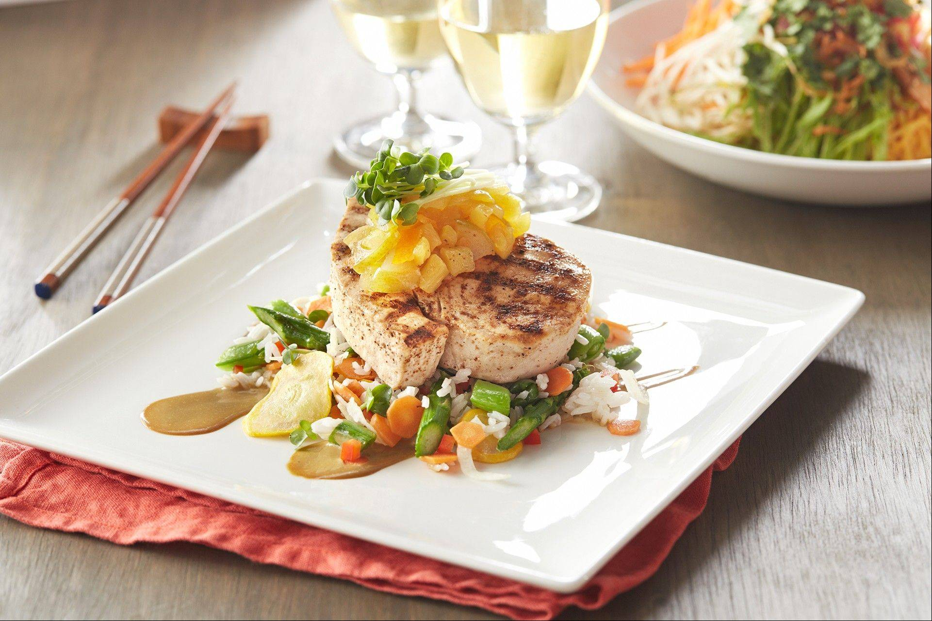 Taste summer in P.F. Chang's grilled pinepple-citrus swordfish with summer rice.