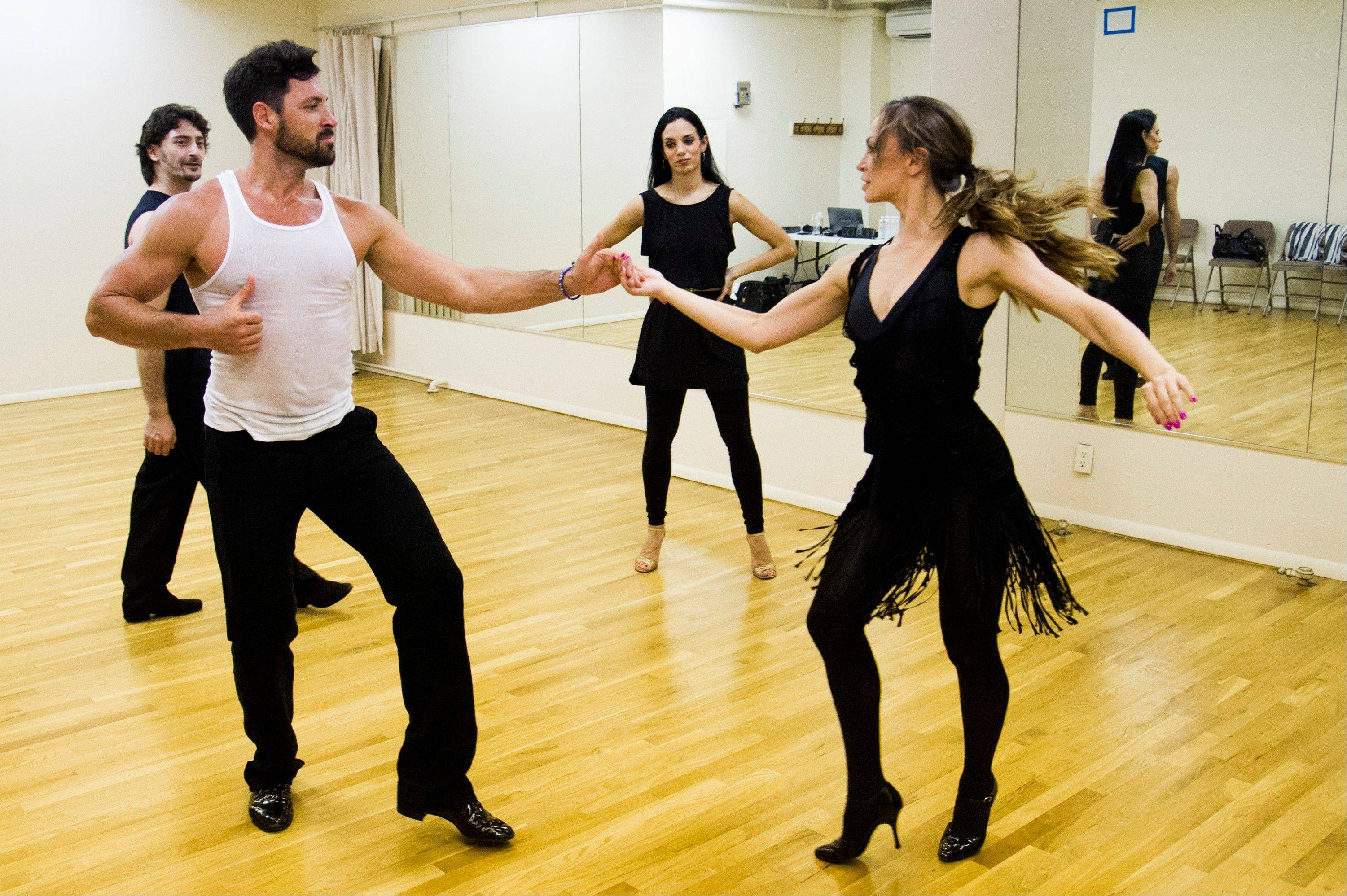 "Karina Smirnoff, right, and Maksim Chmerkovskiy rehearse for the upcoming Broadway show ""Forever Tango"" as Juan Horvath, background left, and Victoria Galoto, watch."