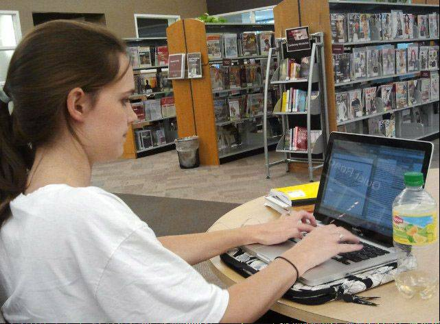 Lauren Ferguson works on a college paper at the Vernon Area Public Library in Lincolnshire. She was one of the many new patrons who signed up for library cards after a recent $1.3 million renovation.