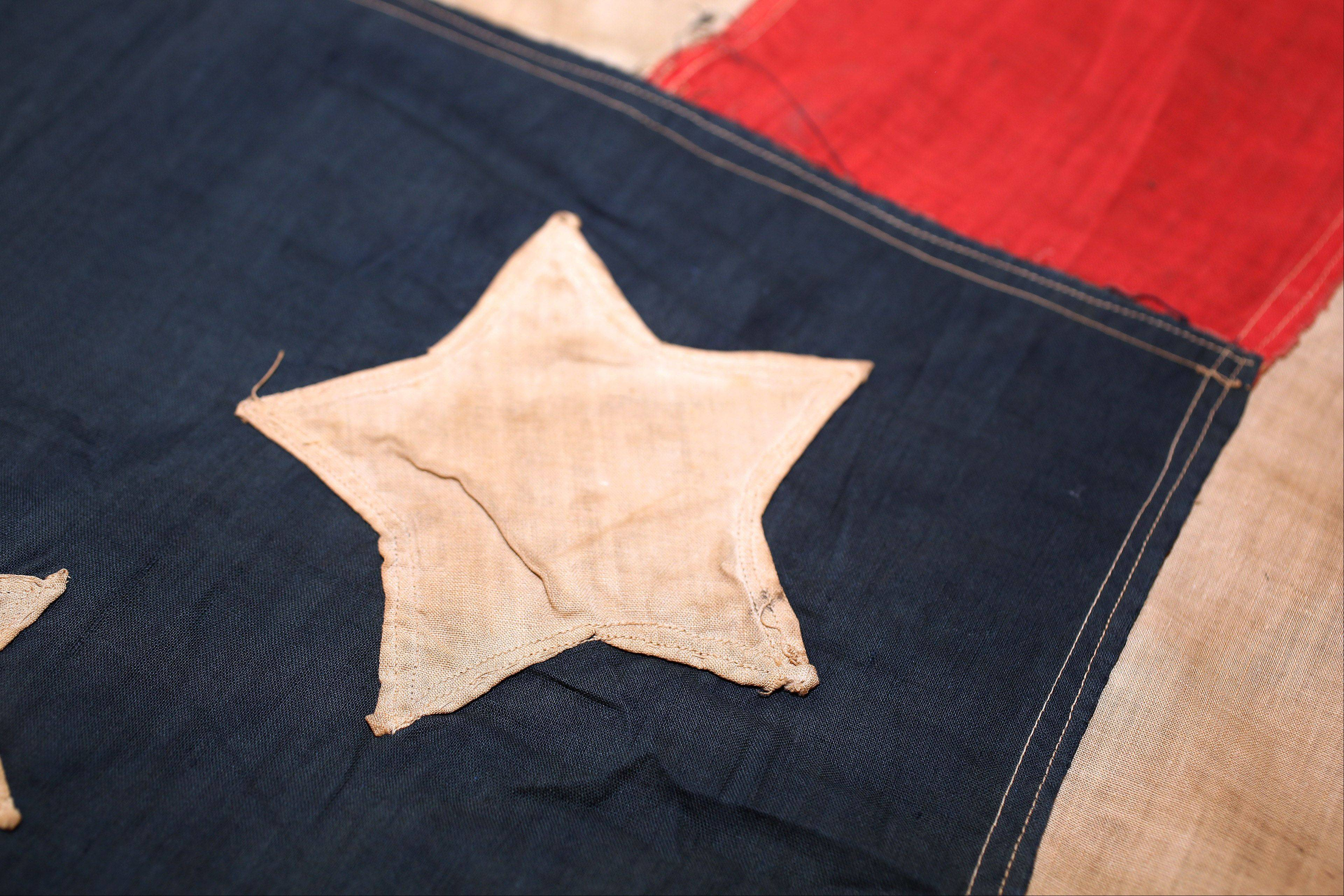 A section of a Civil War flag set up for viewing Wednesday at the Lake County Discovery Museum near Wauconda. The flag was donated by descendants of Civil War veteran Edward Murray after it was found hidden in a shoe box. On July 13 and 14, the Lakewood Forest Preserve will be hosting its annual Civil War Days encampment.