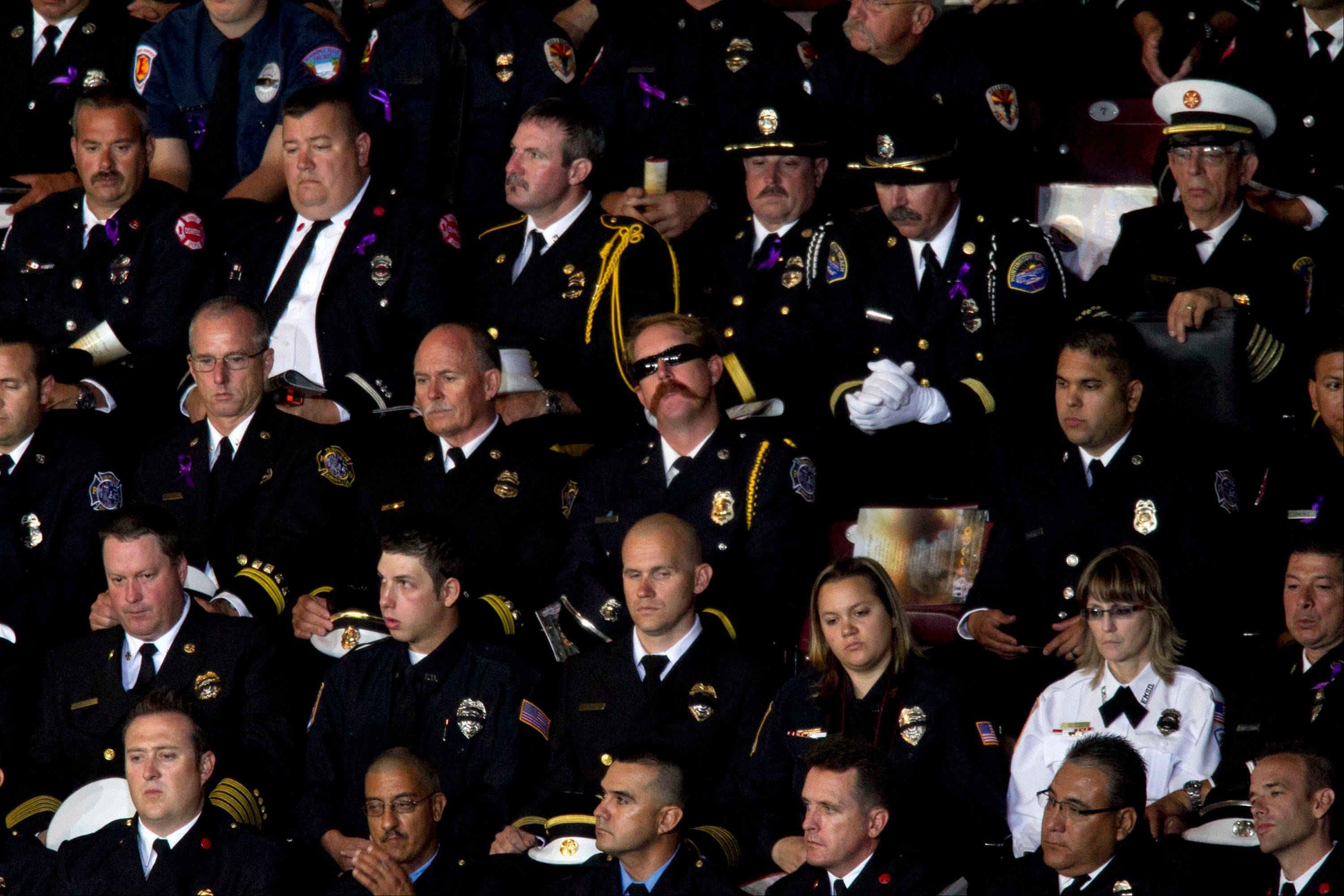 "Firefighters listen during the ""Our Fallen Brother"" memorial service for the 19 fallen firefighers at Tim's Toyota Center in Prescott Valley, Ariz. on Tuesday, July 9, 2013."