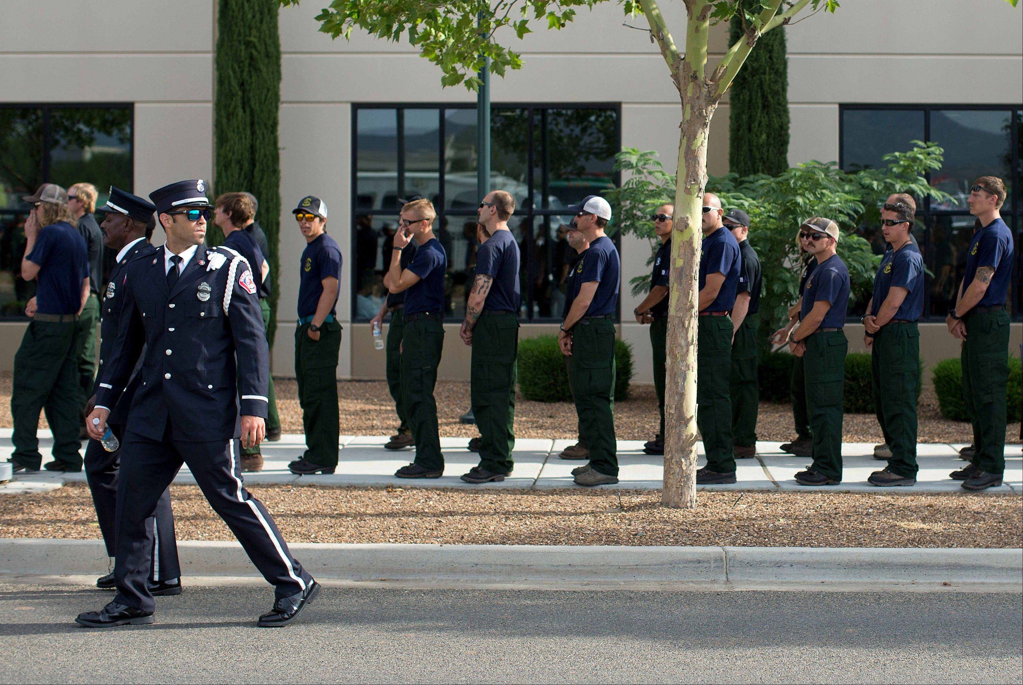 Firefighters from around the country line up outside Tim's Toyota Center, Tuesday, July 9, 2013 in Prescott, Ariz..