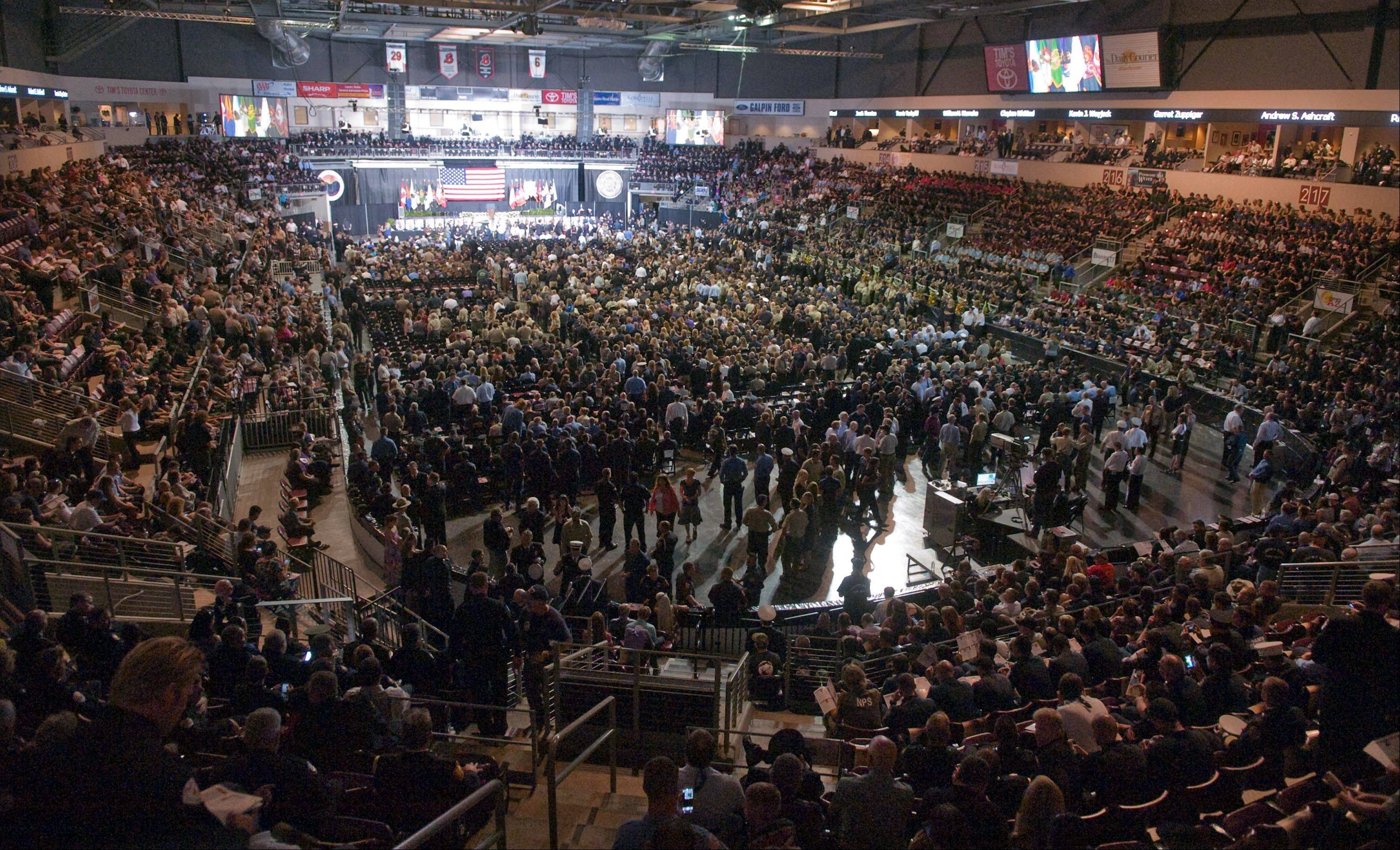 Thousands attend a memorial service for the 19 Hotshot firefighters at Tim's Toyota Center in Prescott Valley, Ariz. on Tuesday, July 9, 2013.