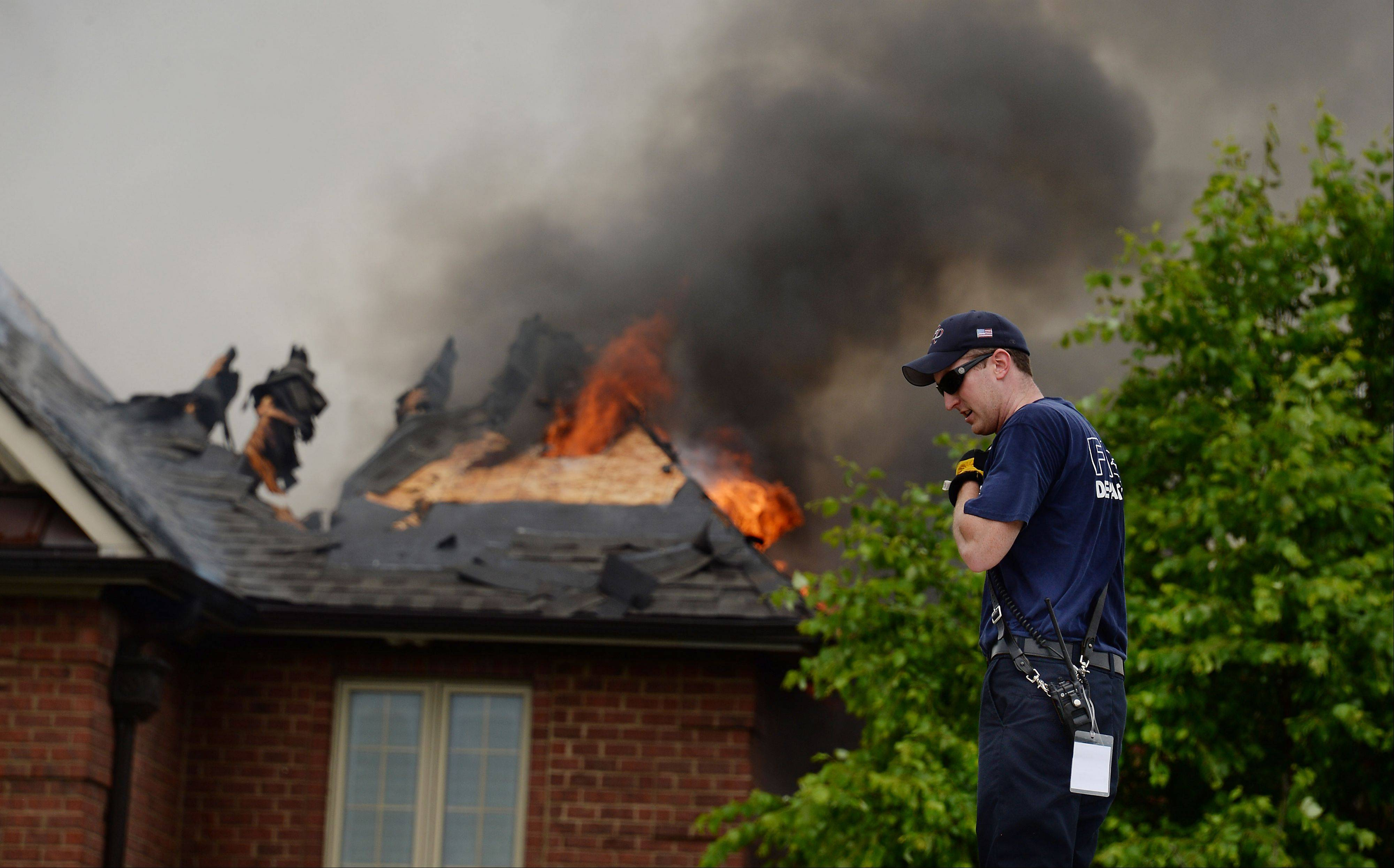 Firefighters from a dozen neighboring fire departments converge on South Barrington to help.