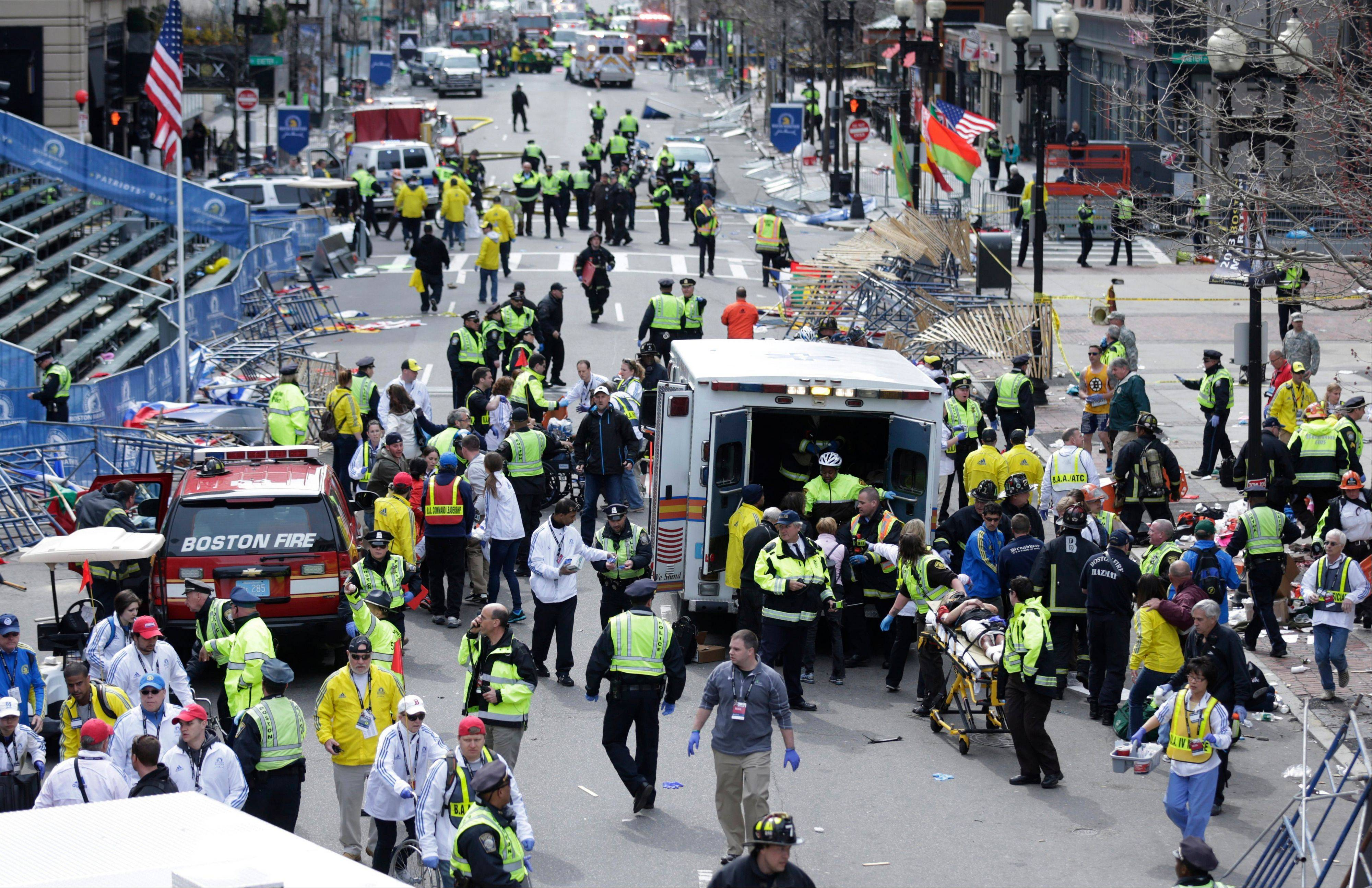 This April 15, 2013 file photo shows medical workers aiding injured people at the finish line of the 2013 Boston Marathon in Boston following an explosion. If the Obama administration seeks the death penalty against Boston Marathon bombing suspect Dzhokhar Tsarnaev, it would face a long, difficult legal battle.