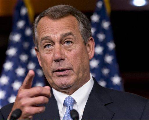 In this June 20, 2013 file photo, House Speaker John Boehner of Ohio gestures during a news conference on Capitol Hill in Washington. The Obama administration's abrupt delay of the health insurance mandate for employers saves Democrats a major re-election headache in next year's midterm contests. But it does boost the underlying Republican complaint: The health care law is unworkable and Congress should repeal it.