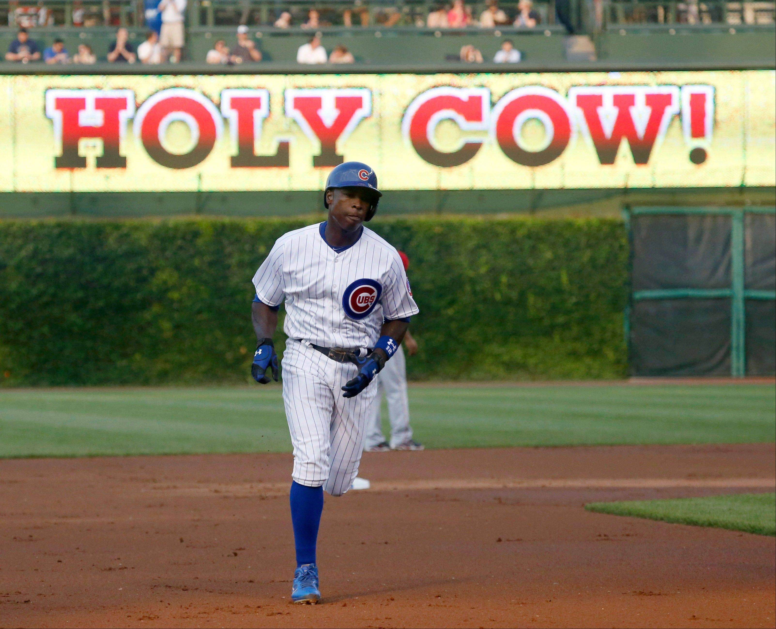 The Cubs' Alfonso Soriano rounds the bases after hitting his first of 2 home runs Tuesday night at Wrigley Field.