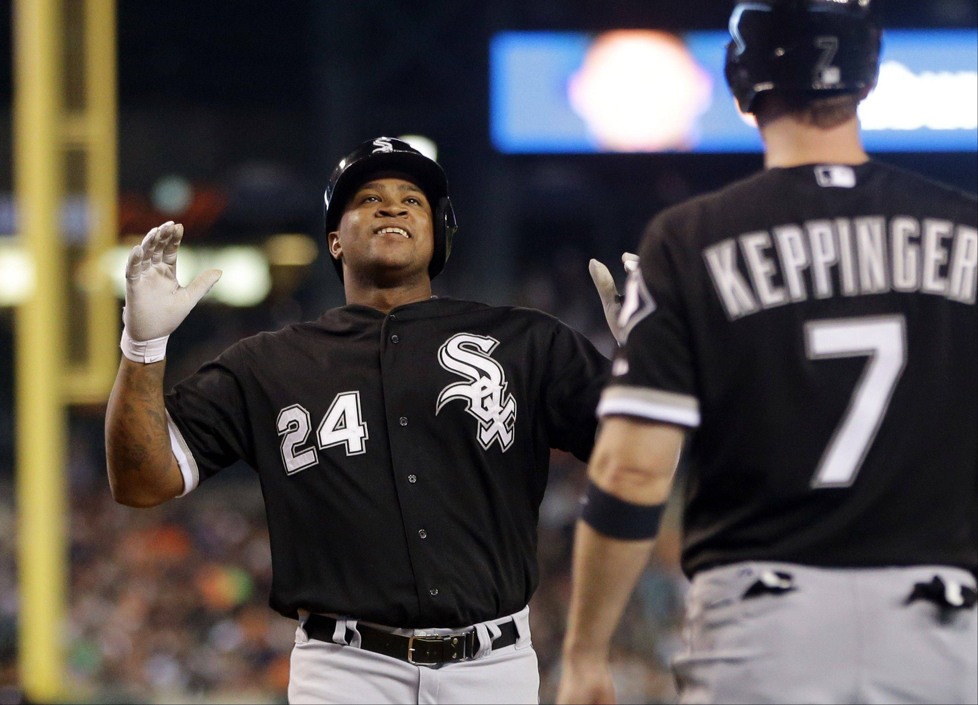 Chicago White Sox's Dayan Viciedo reaches home plate after connecting for a three-run home run off Detroit Tigers relief pitcher Al Alburquerque during the eighth inning of a baseball game in Detroit, Tuesday, July 9, 2013.