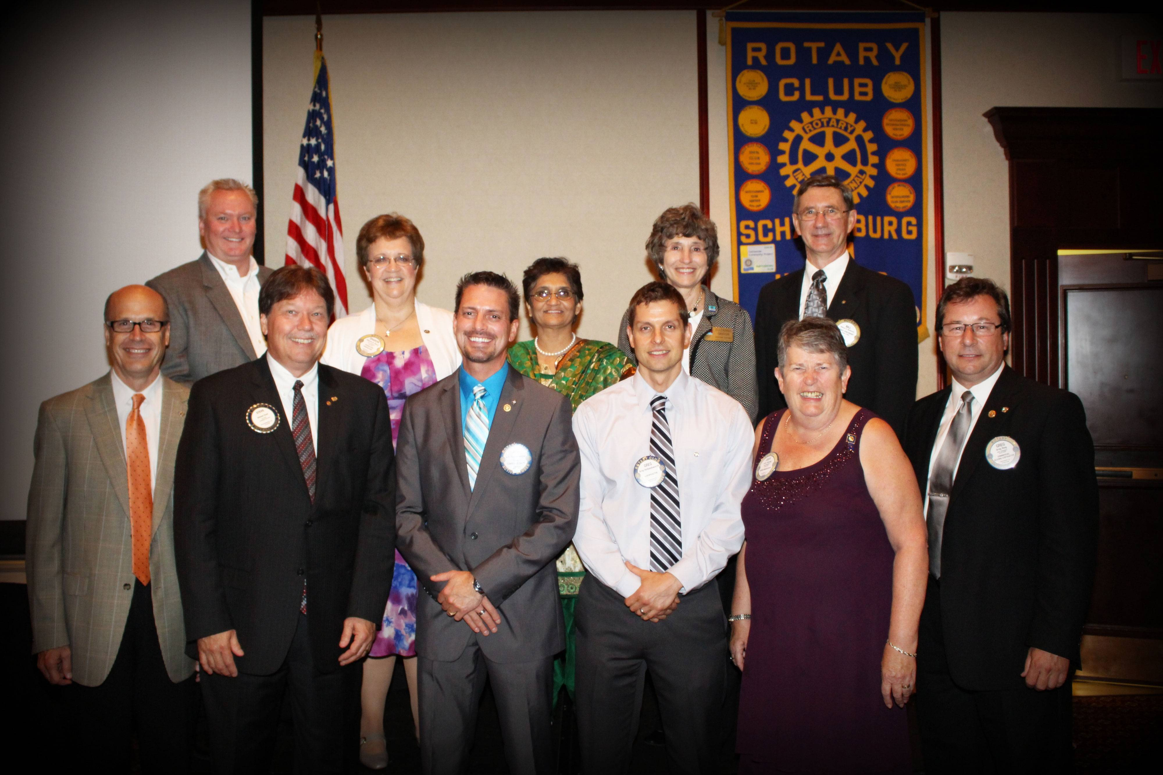 2013/2014 Schaumburg A.M. Rotary Board of Directors includes -  Front Row - L to R - Tim Gerhardt - International & Youth Service Director, Steve East - President Elect, Jeff Winkenwerder -President, Greg Hollandsworth - Vocational Service Director, Judy Hennip - Treasurer, & Greg Ring - Immediate Past President  Back Row - L to R - Brian Bieschke - Club Service Director, Sharon Perry - Public Relations, Vibha Tambe - Community Service Director, Suzanne Gibson, - Dist. 6440 Asst. Governor & Bill Matthews - Secretary