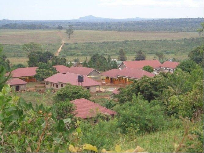 The completed COVE Alliance campus in Uganda, equipped with a medical dispensary, classrooms for grades 1-5, two dormitories, two kitchens, a playground, a basketball court and administrative offices.
