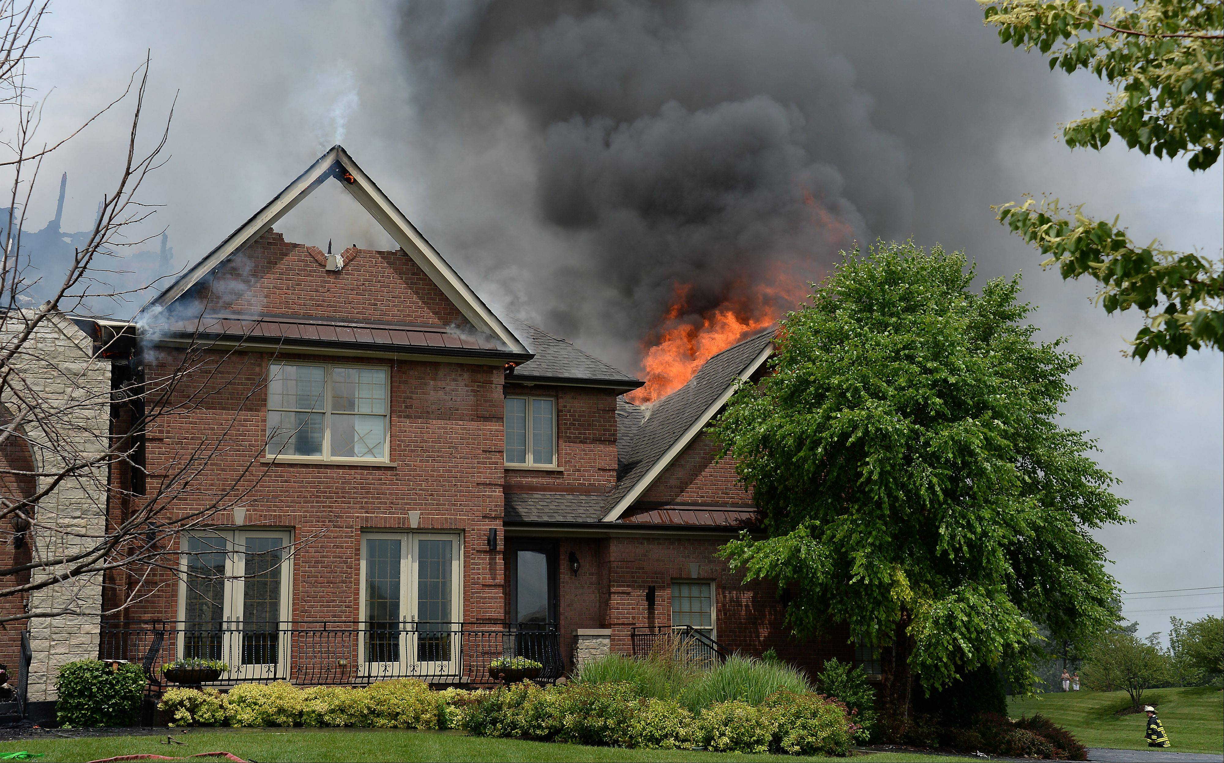 Firefighters from throughout the Northwest suburbs fought a blaze at a South Barrington house Tuesday afternoon which investigators later confirmed had been caused by a lighting strike.