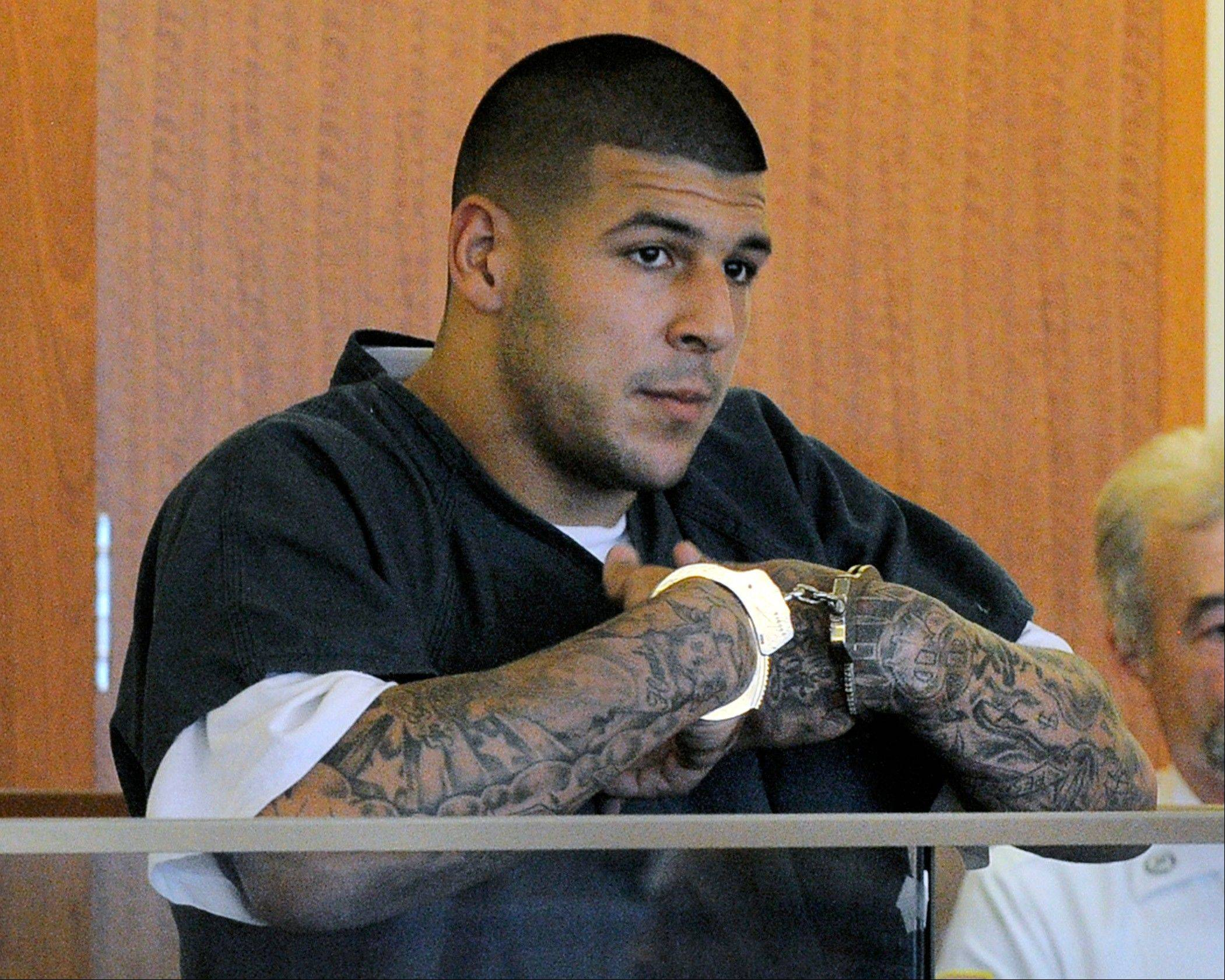 An associate of former New England Patriots tight end Aaron Hernandez said he was told Hernandez fired the shots that resulted in the death of a semipro football player, according to documents filed in Florida. The records say Hernandez associate Carlos Ortiz told Massachusetts investigators that another man, Ernest Wallace, said Hernandez shot Lloyd in an industrial park near Hernandez�s home in North Attleborough.