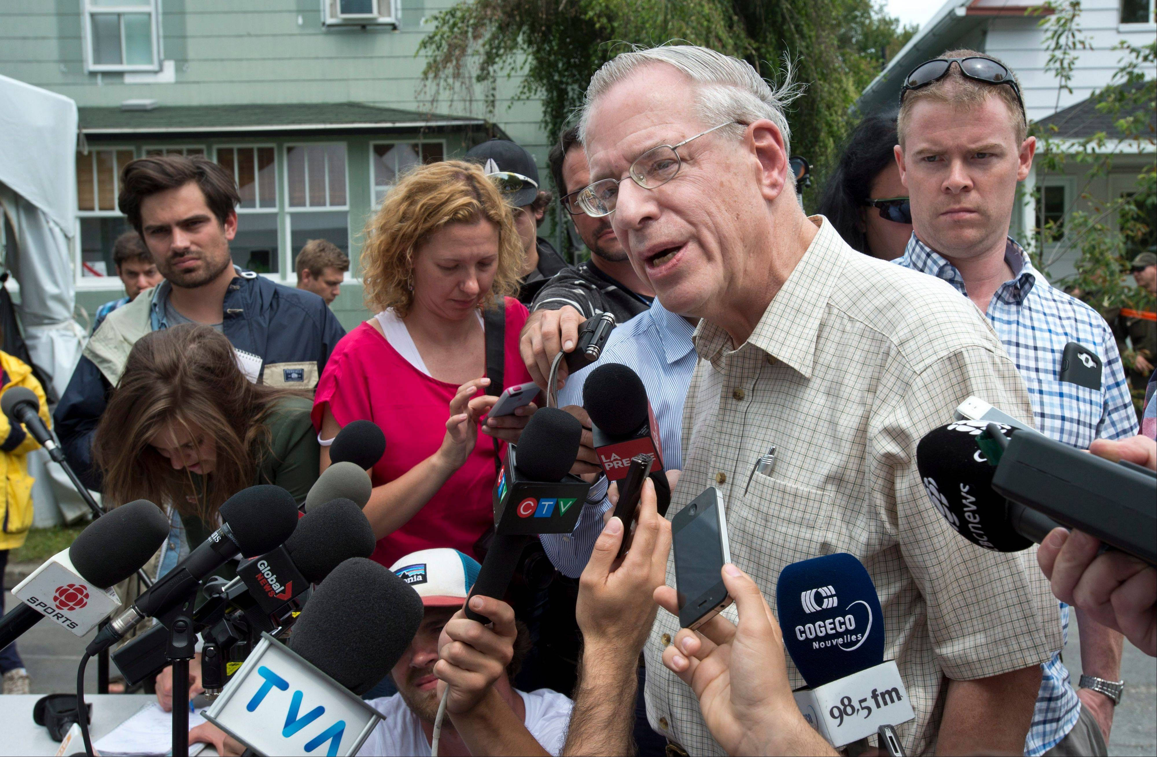 Rail World Inc. president Edward Burkhardt speaks to the media as he tours Lac-Megantic, Quebec, Wednesday. A Rail World train crashed into the town killing at least 15 people. Burkhardt blamed the accident on an employee who he said had failed to properly set the brakes.