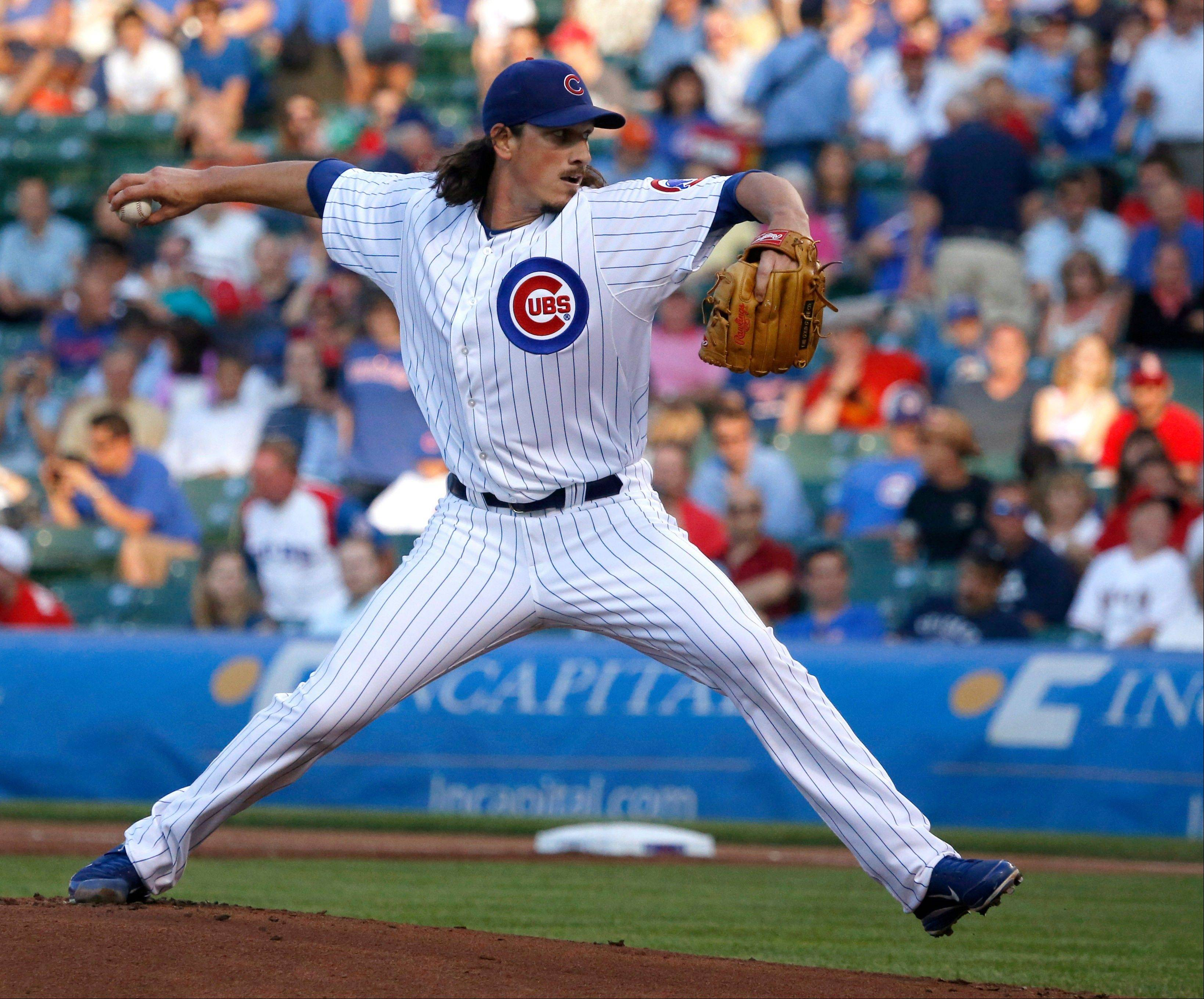 Cubs starting pitcher Jeff Samardzija delivers during the first inning of an interleague baseball game against the Los Angeles Angels on Wednesday, July 10, 2013, in Chicago.