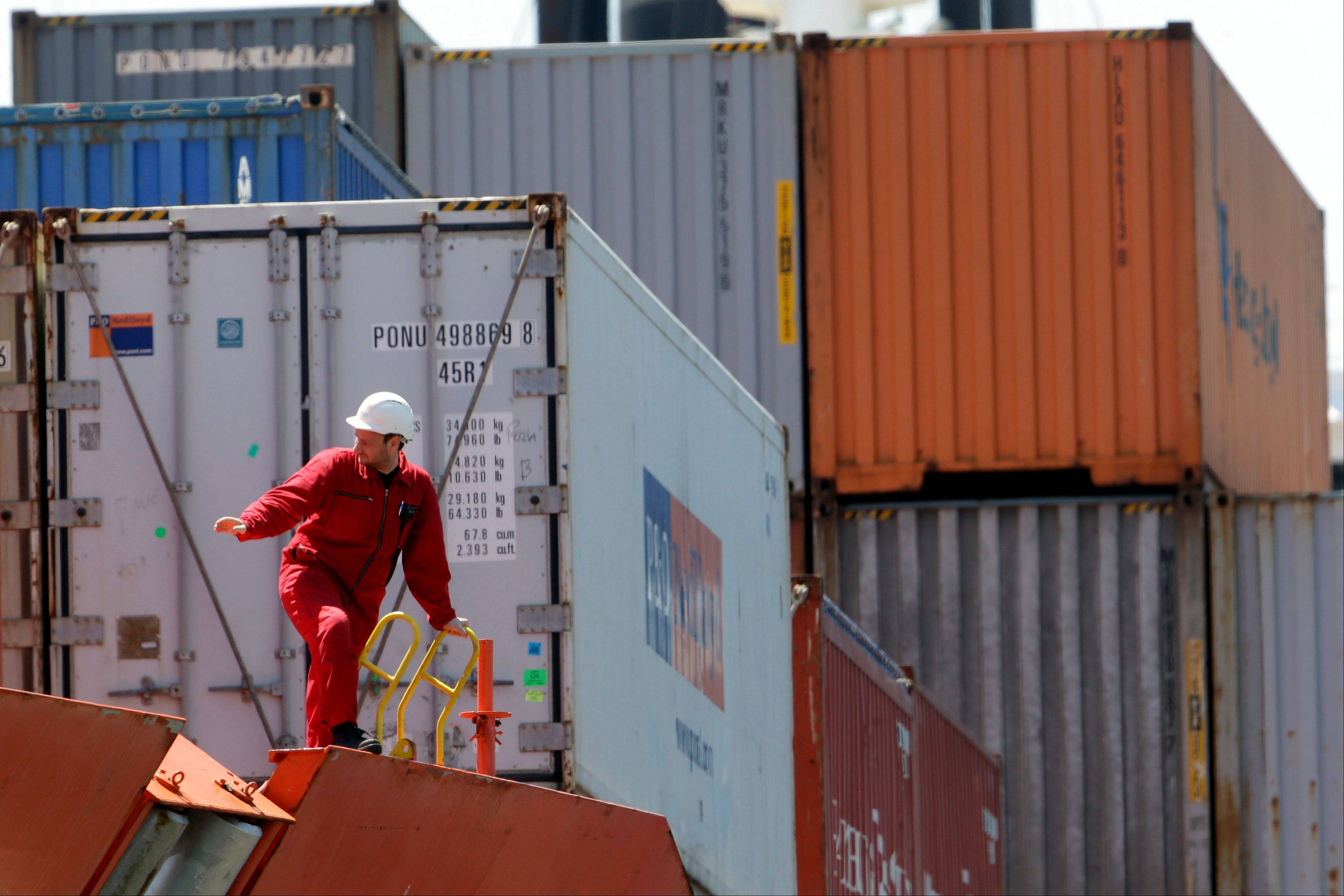 Cargo containers are docked at Packer Avenue Marine Terminal, in Philadelphia. Inventories at U.S. wholesalers unexpectedly declined in May by the most since September 2011 as sales surged, pointing to a pickup in orders and production.