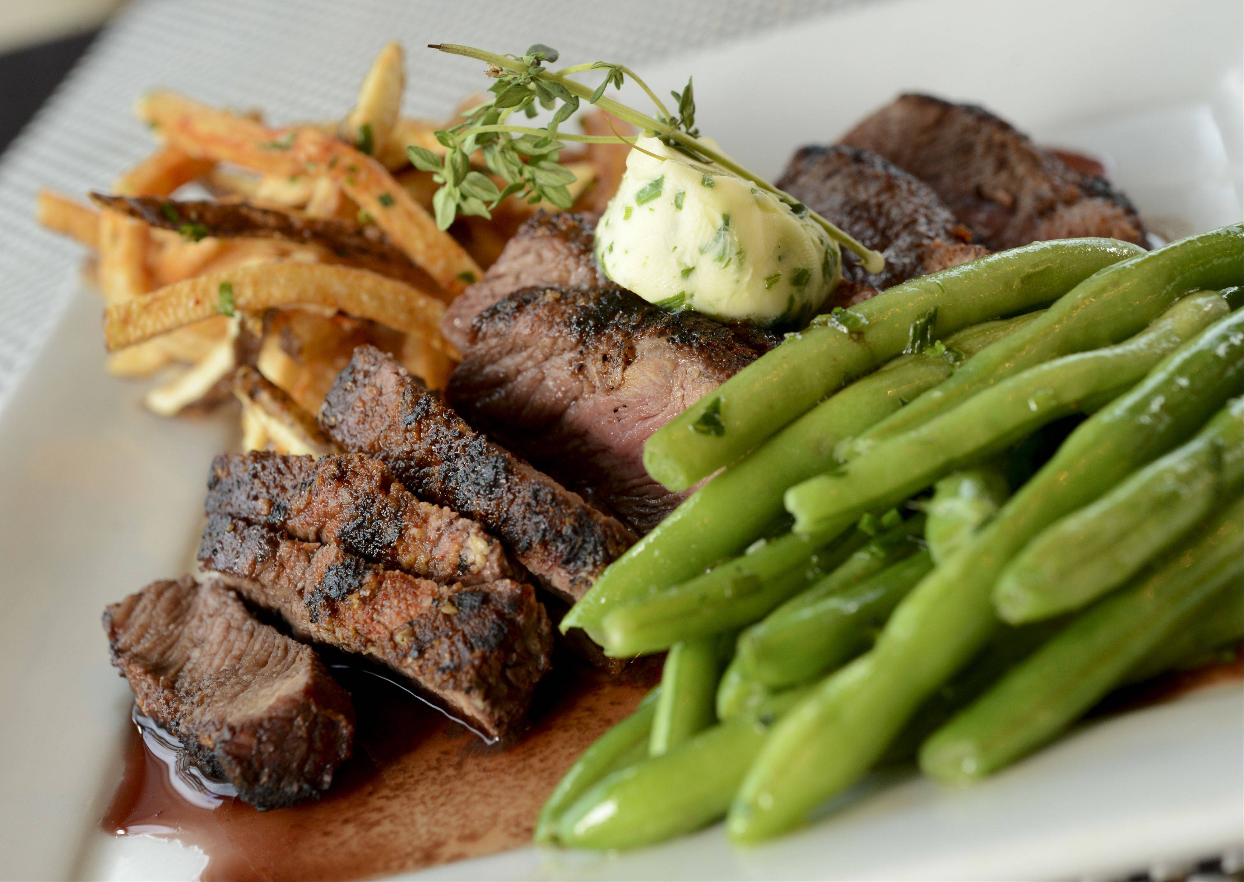 Grilled hanger steak comes with a rich burgundy sauce at Paris Bistro in Naperville.