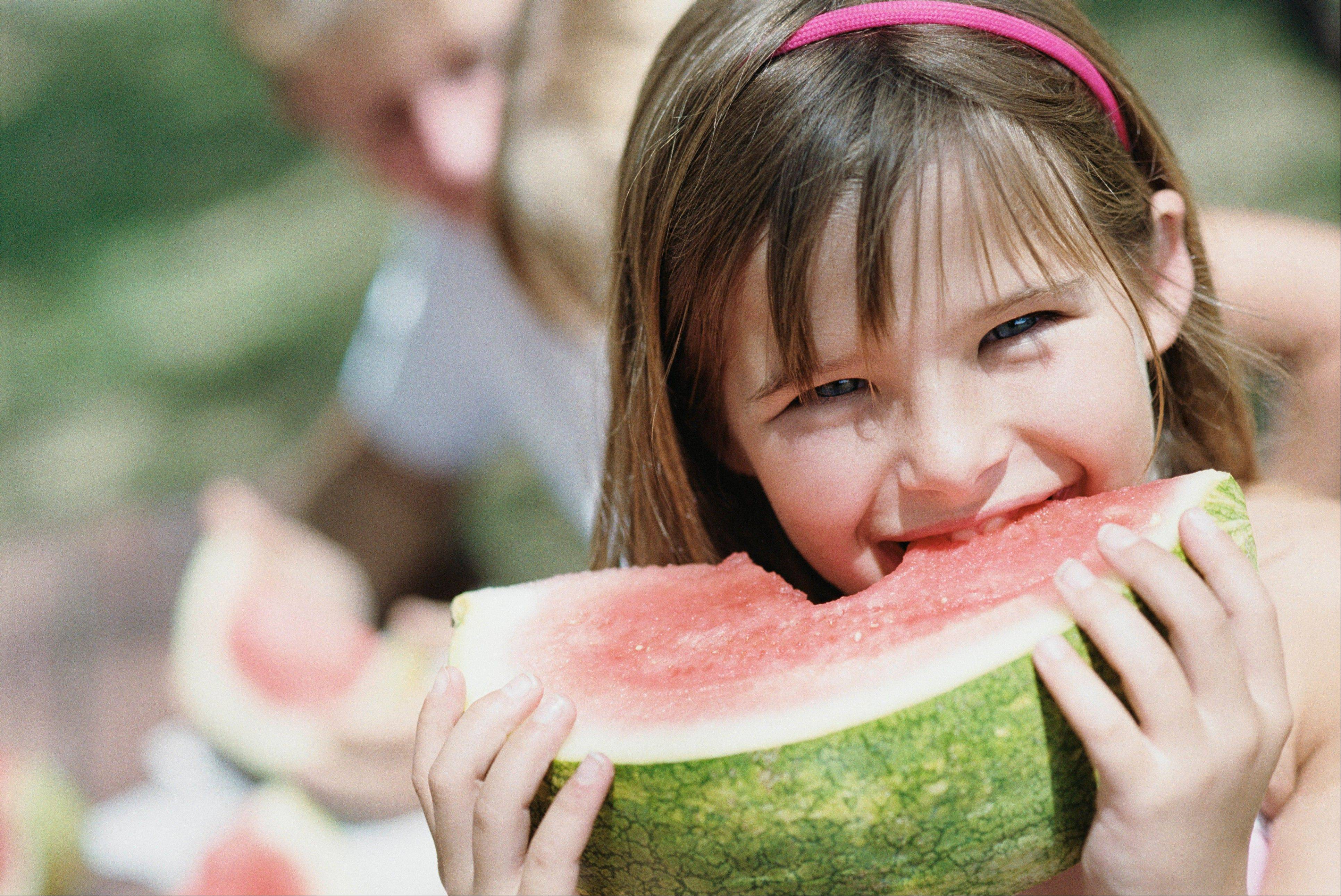 Provide fruits with high water content like watermelon for your kids to eat during the summer.
