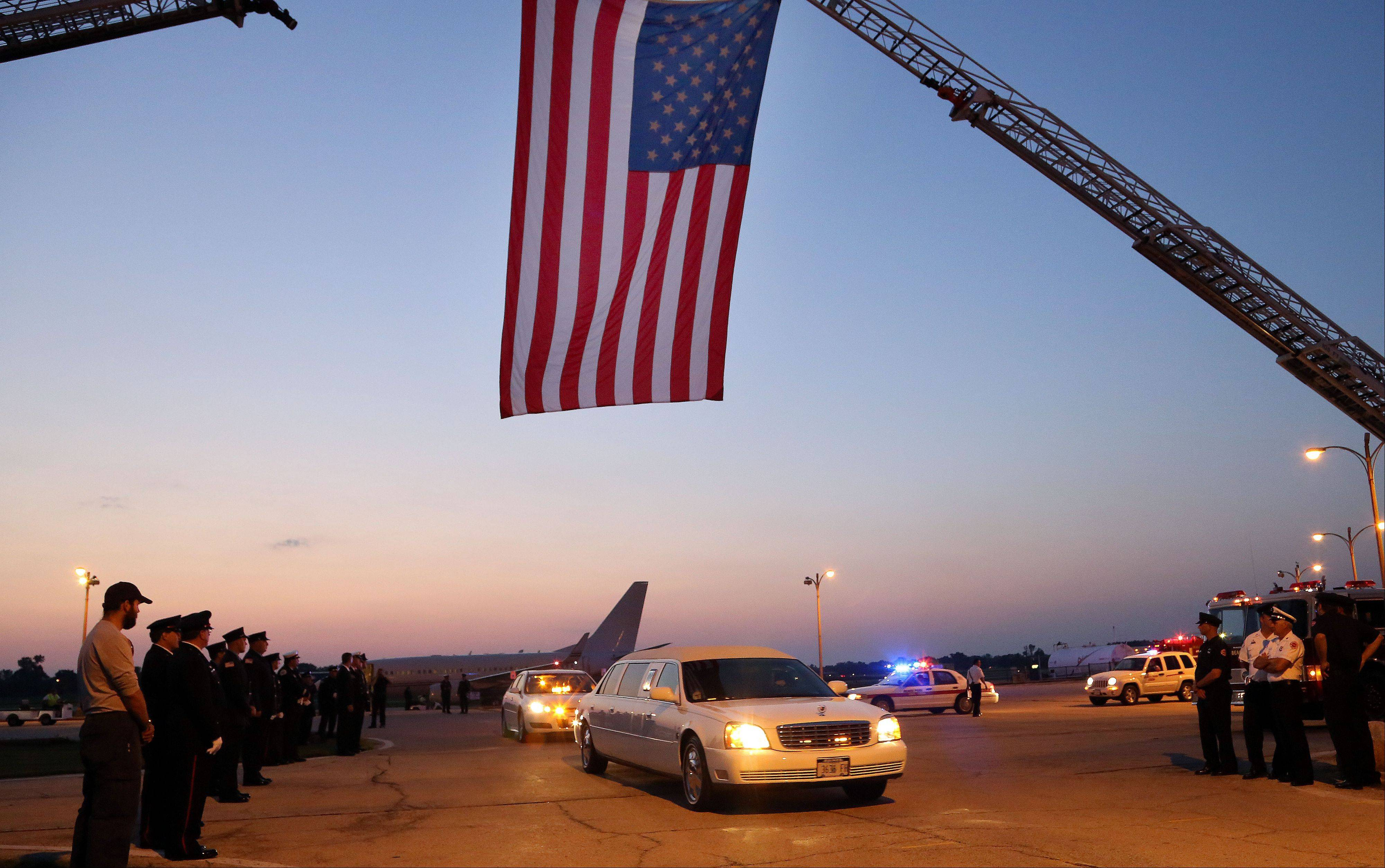 Family members leave Waukegan Regional Airport with the remains of their son Anthony Rose of Beach Park Wednesday. Rose was killed June 30 along with other members of the Granite Mountain Hotshots while battling a wildfire north of Phoenix.