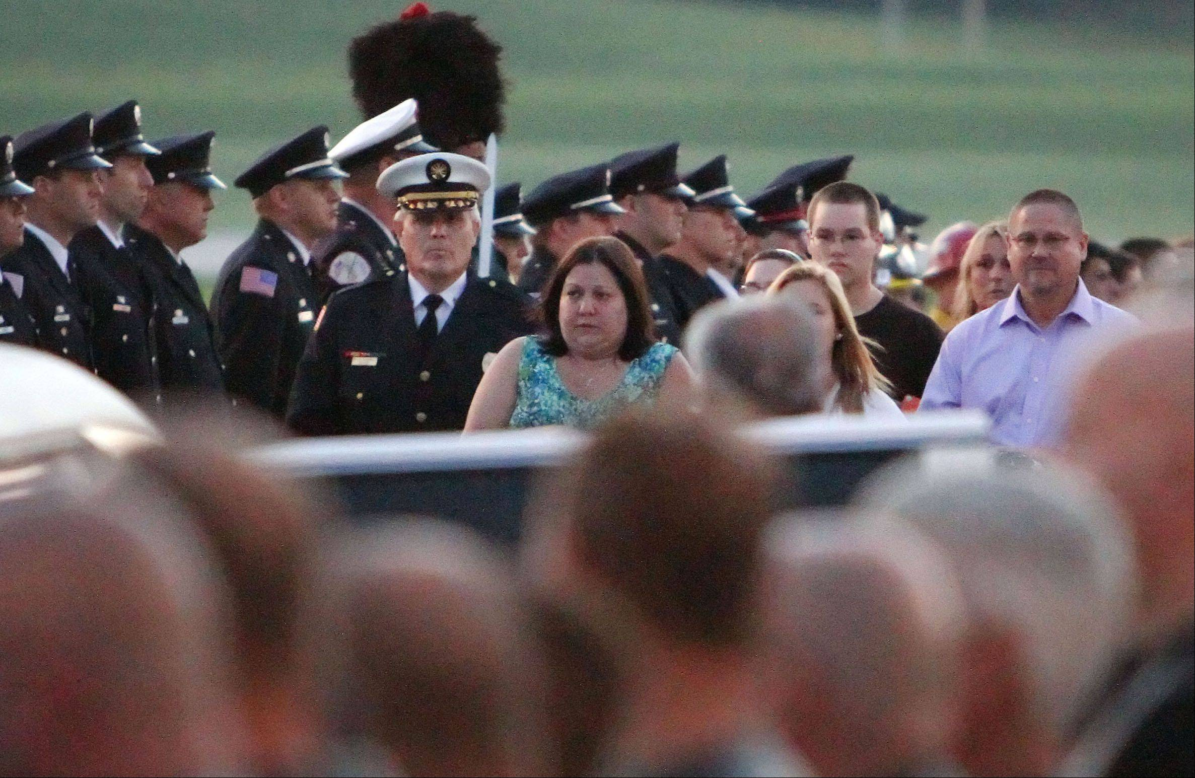 Family members walk to a limo with the remains of Anthony Rose of Beach Park at Waukegan Regional Airport Wednesday night. Rose was killed June 30 along with other members of the Granite Mountain Hotshots while battling a wildfire north of Phoenix.