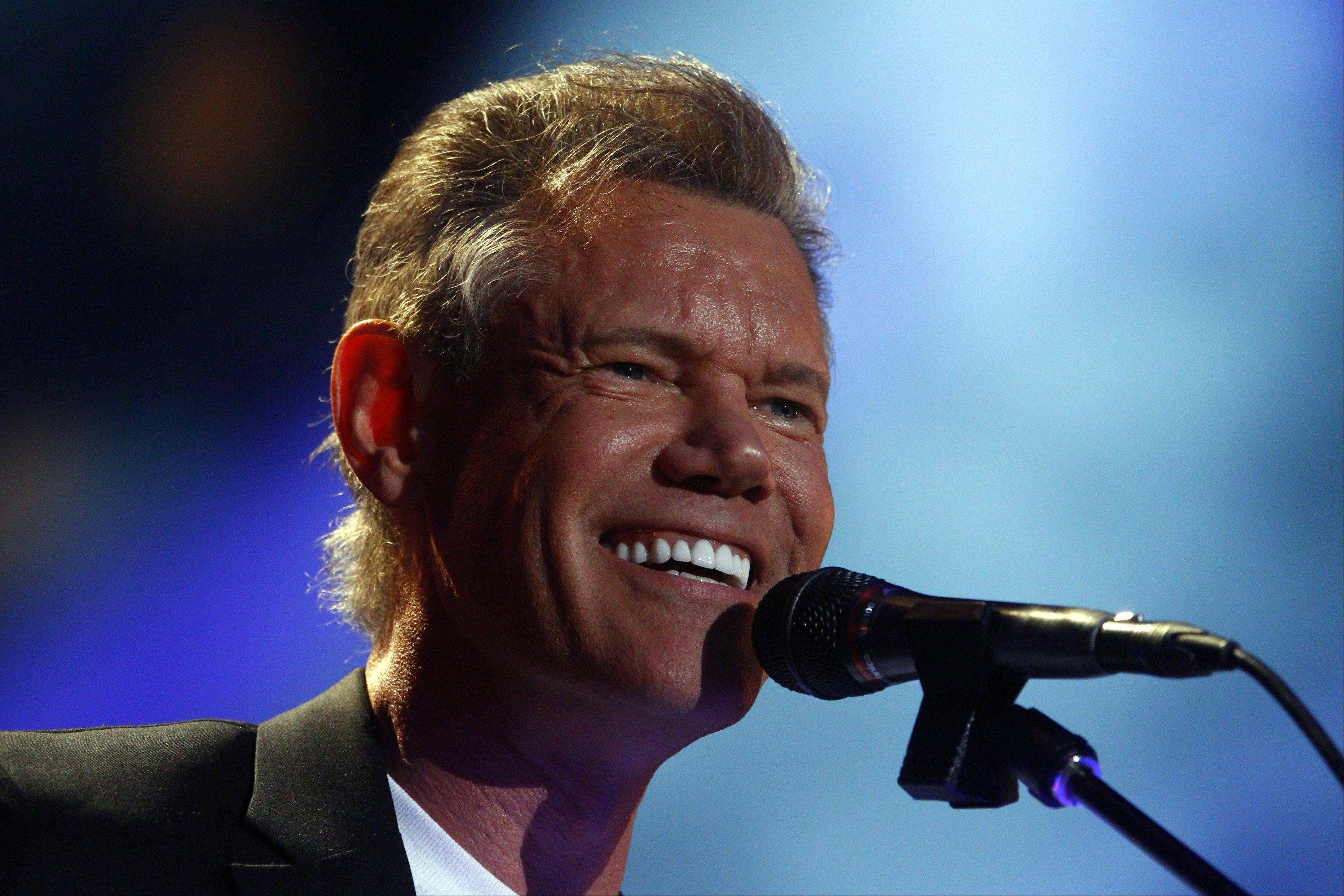 Randy Travis' publicist said Wednesday the 54-year-old Travis is in surgery after suffering a stroke while he was being treated for congestive heart failure because of a viral illness.