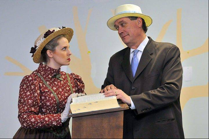 "Elroy ""Sandy"" Sandquist plays Professor Harold Hill, and Jessica Means plays River City librarian Marian Paroo in a scene from ""The Music Man."""