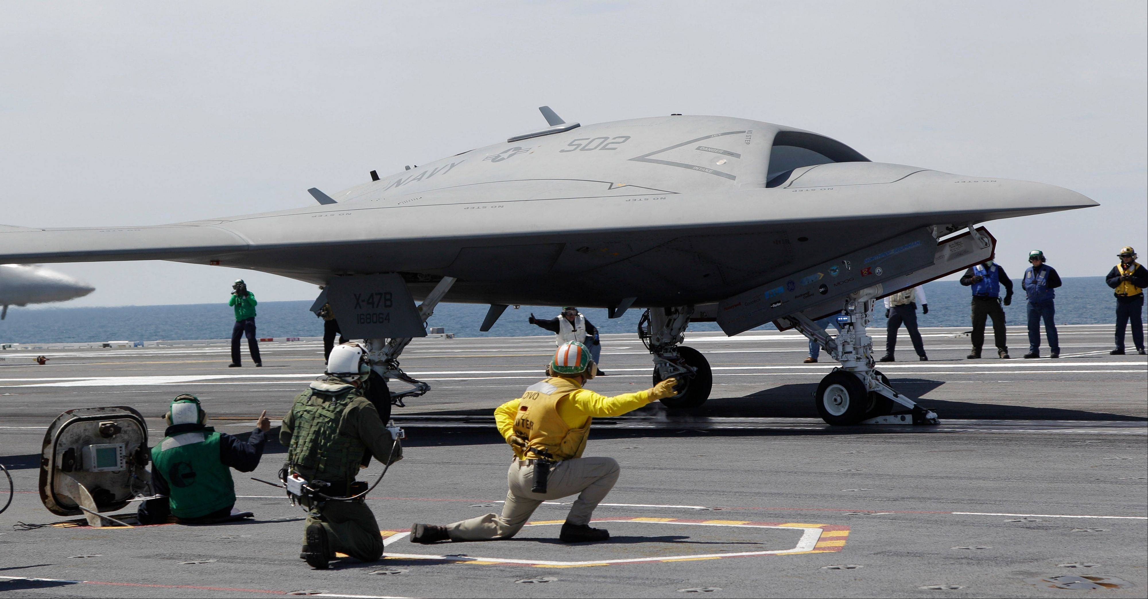 A Navy X-47B drone is launched off the nuclear powered aircraft carrier USS George H.W. Bush off the coast of Virginia on May 14, 2013. The X-47B experimental aircraft completed the first unmanned carrier landing aboard the USS George H.W. Bush on Wednesday July 10, 2013.